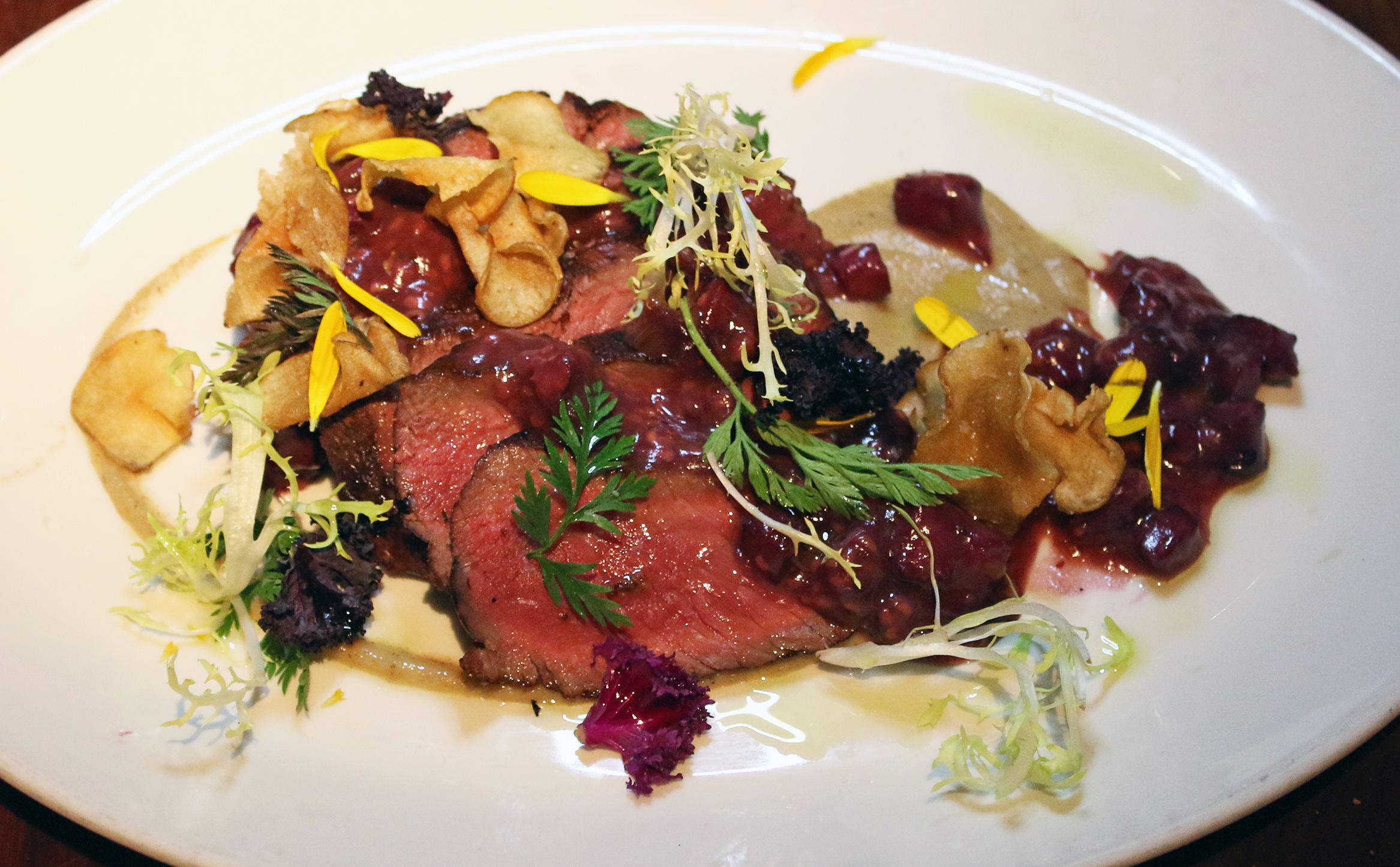 Grilled CA Sage Brush Venison: Sunchoke Chips & Puree Duck Prosciutto & Berry Jam