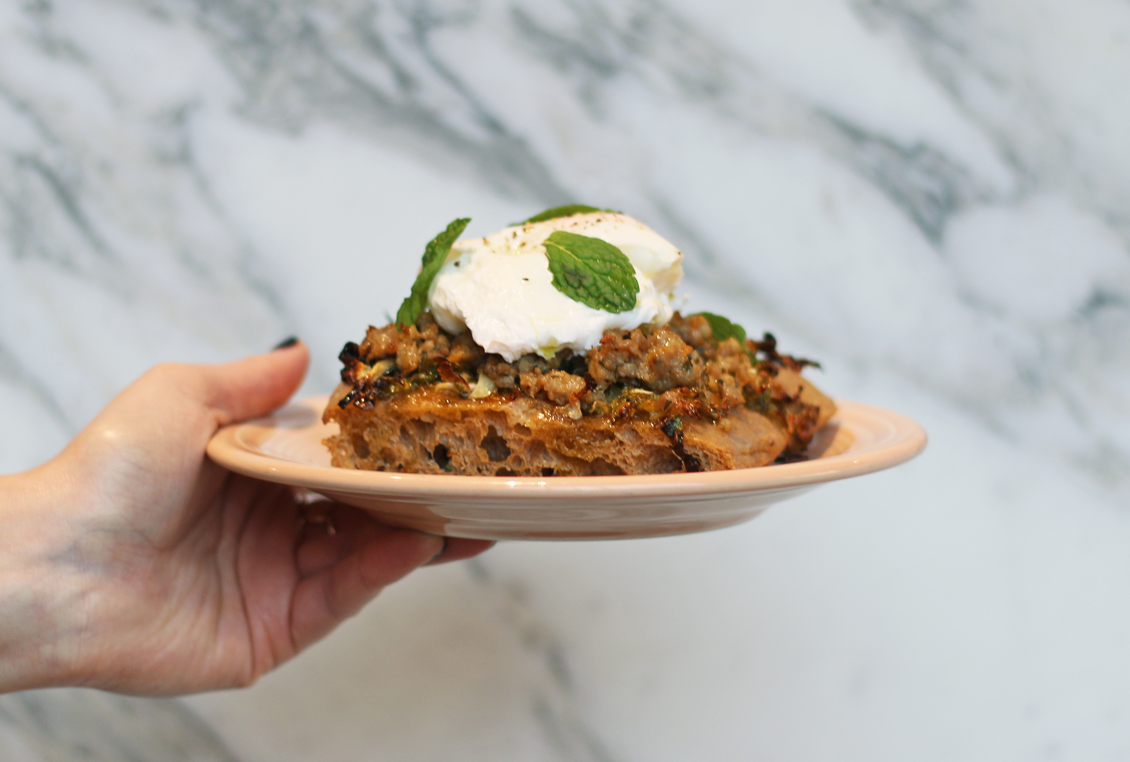 Focaccia Flatbread with Brussels Sprouts, Sausage, and Poached Egg