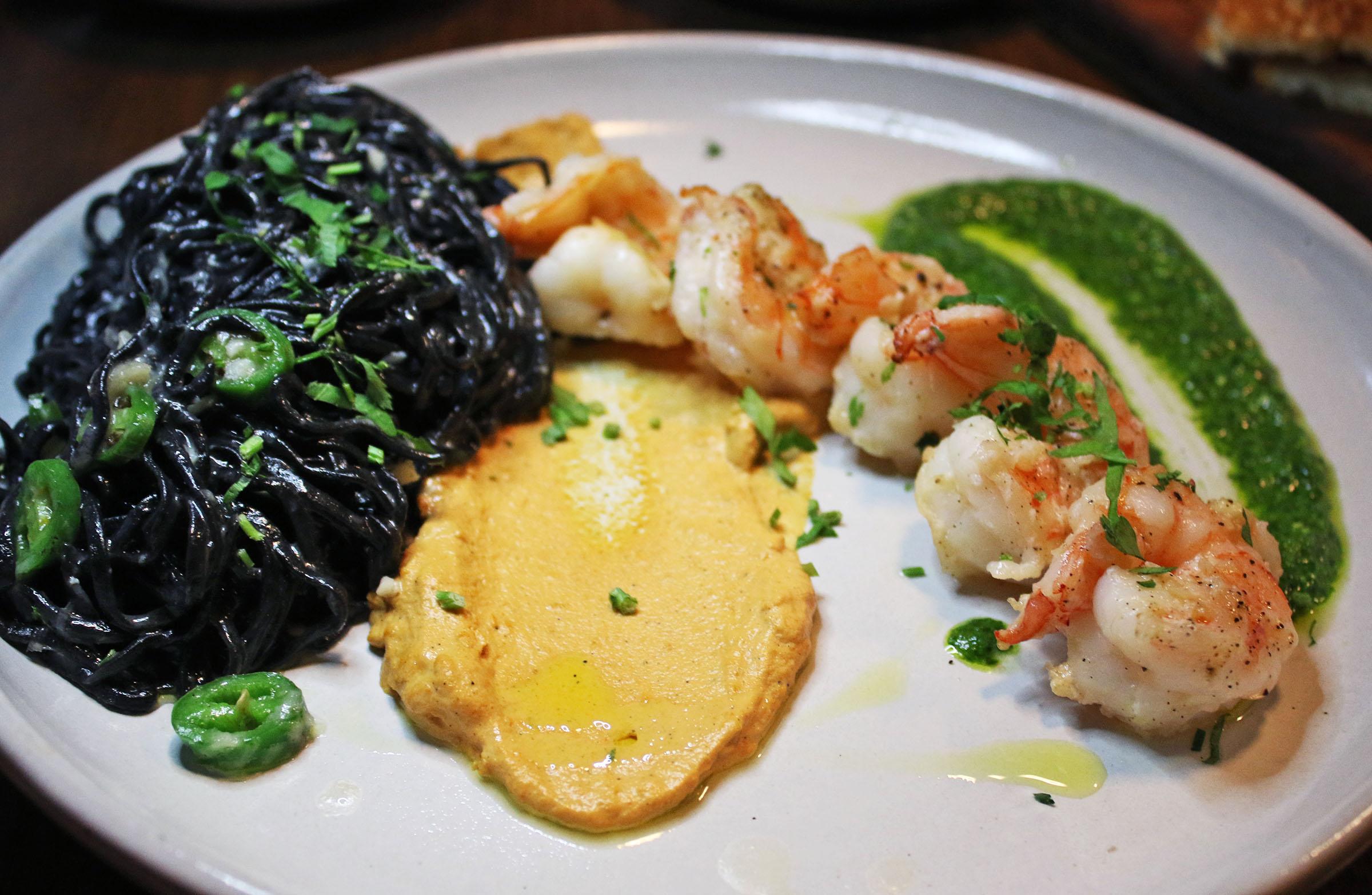 Squid Ink Spaghetti: Prawns, Romesco, Arugula Pesto and Serrano Peppers