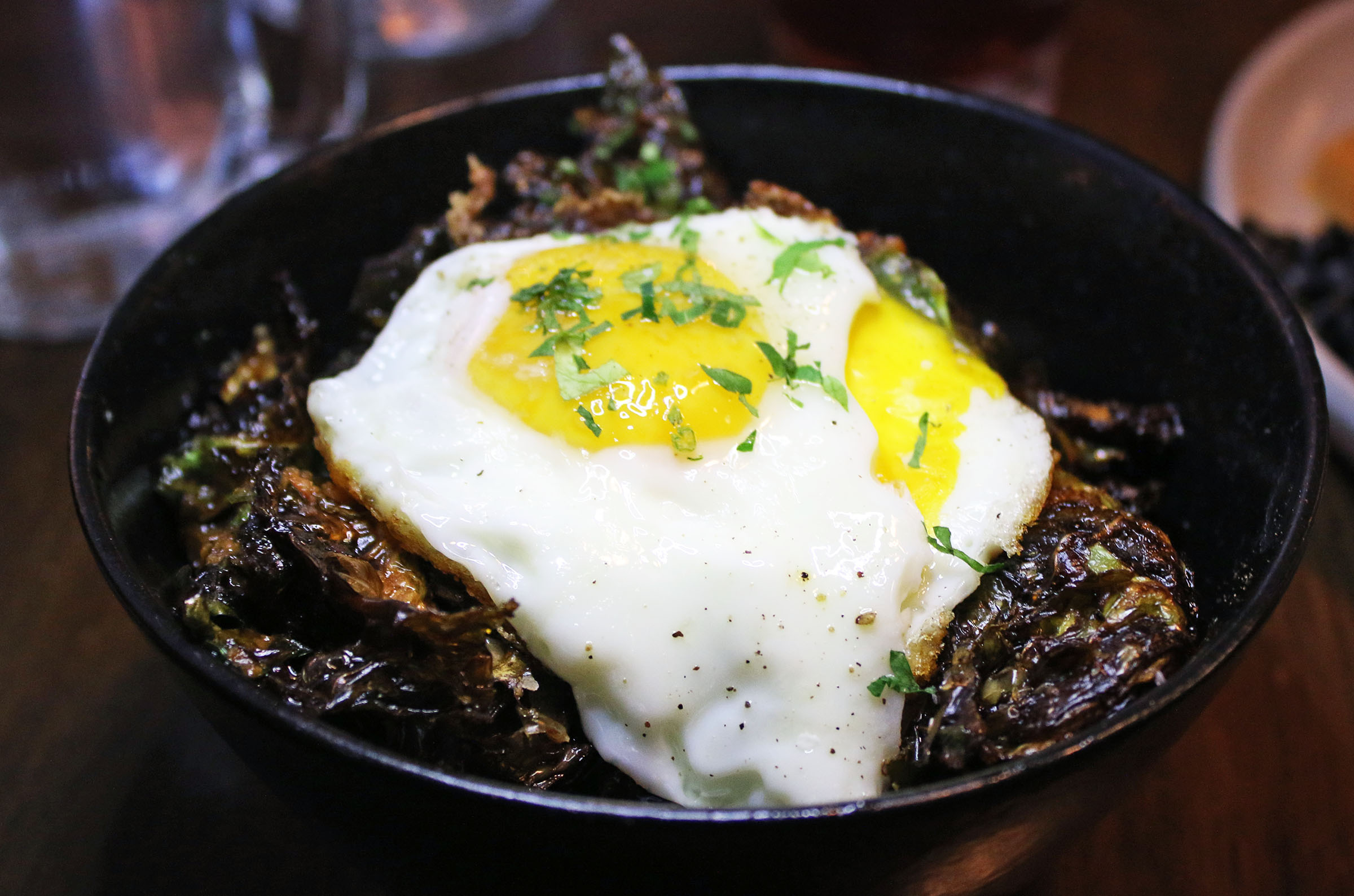 Crispy Fried Brussels Sproutswith chili vinaigrette, lime crème and a sunny-side egg