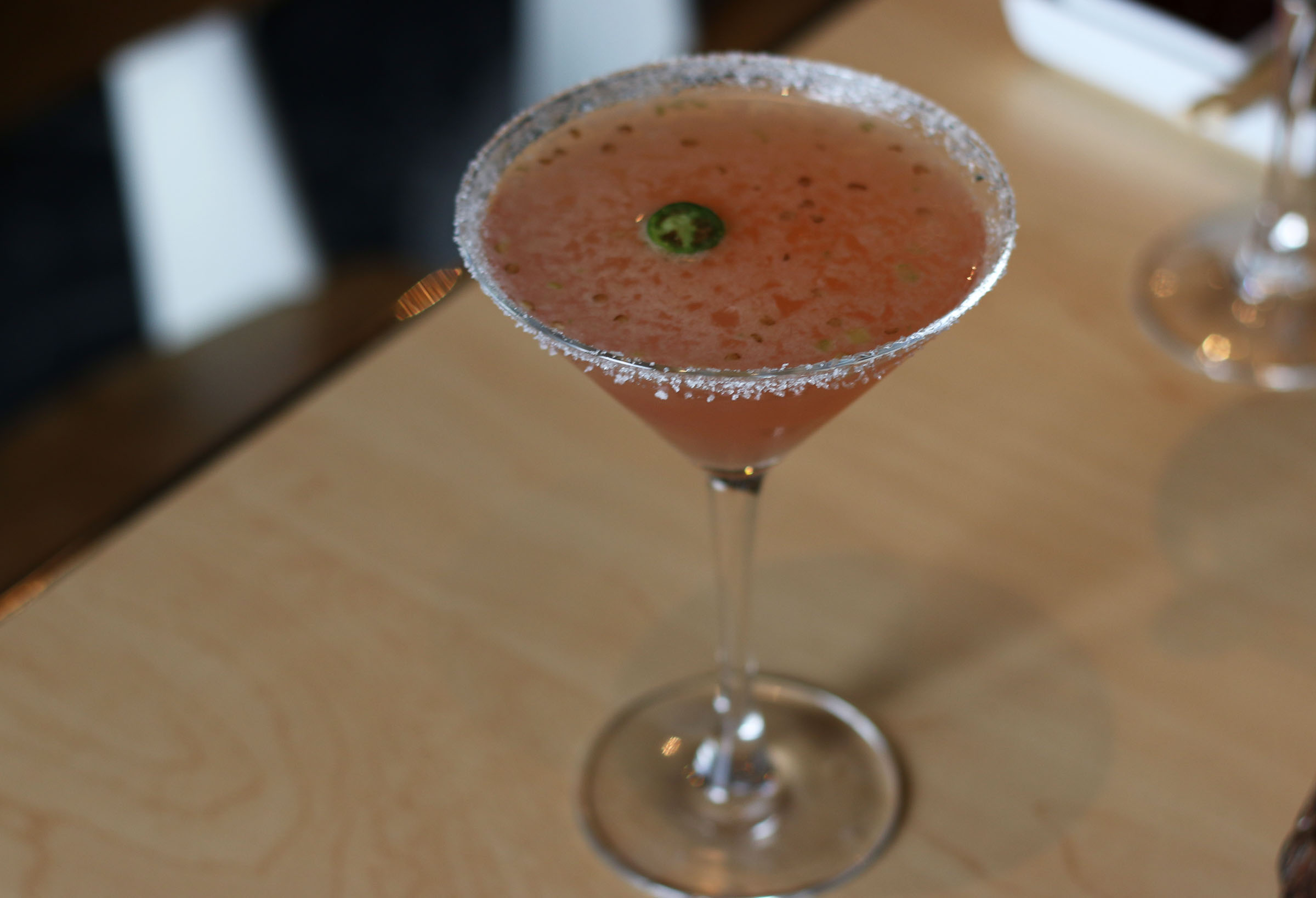 BURNING MANDARIN: Absolut Mandarin Vodka, hand-crushed serrano chili, fresh lemon and orange juice with a splash of cranberry.