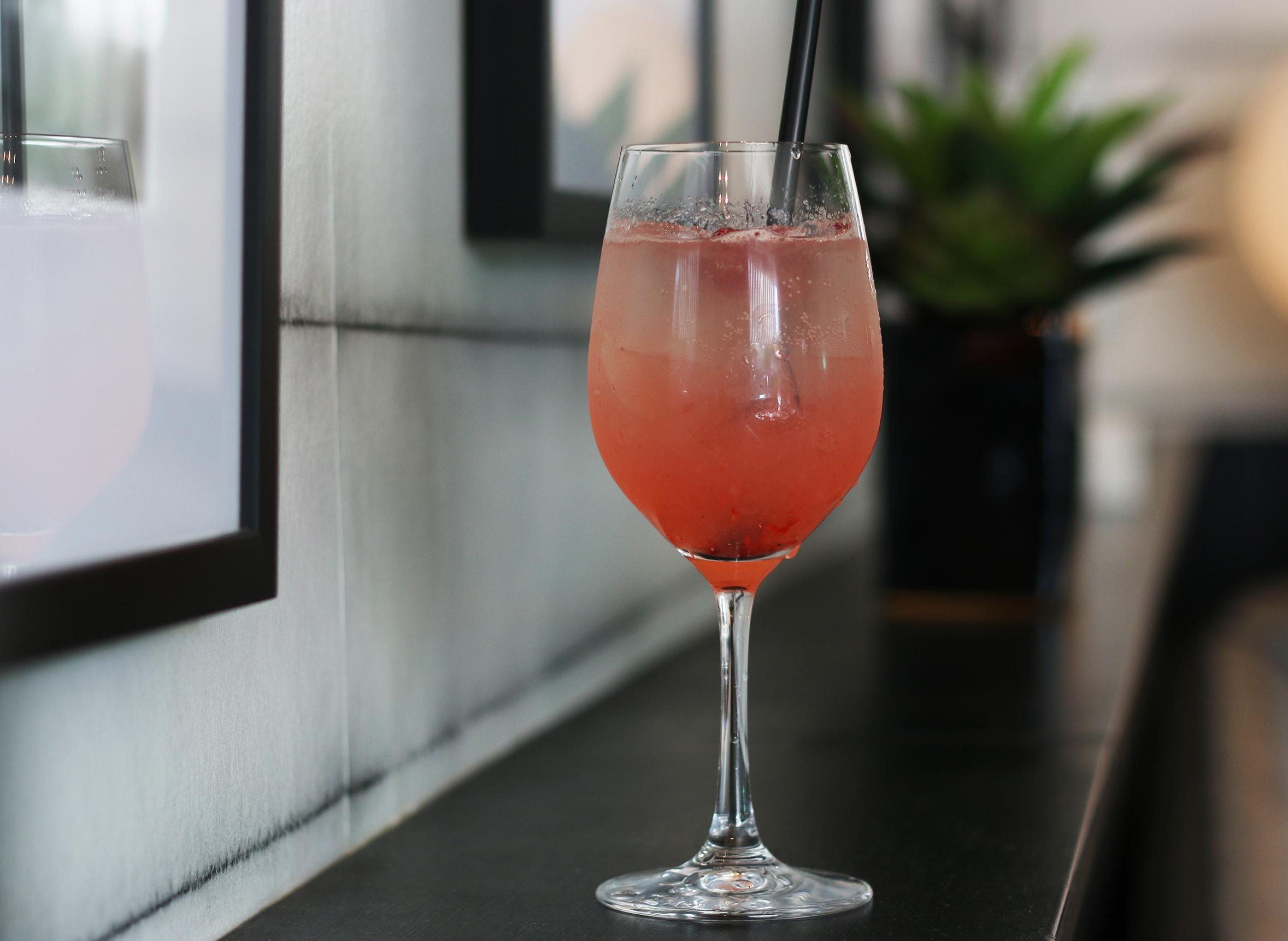 THE LOLITA : Belvedere Cherry Vodka, lemon juice, simple syrup, raspberries, ruffino prosecco, raspberry garnish