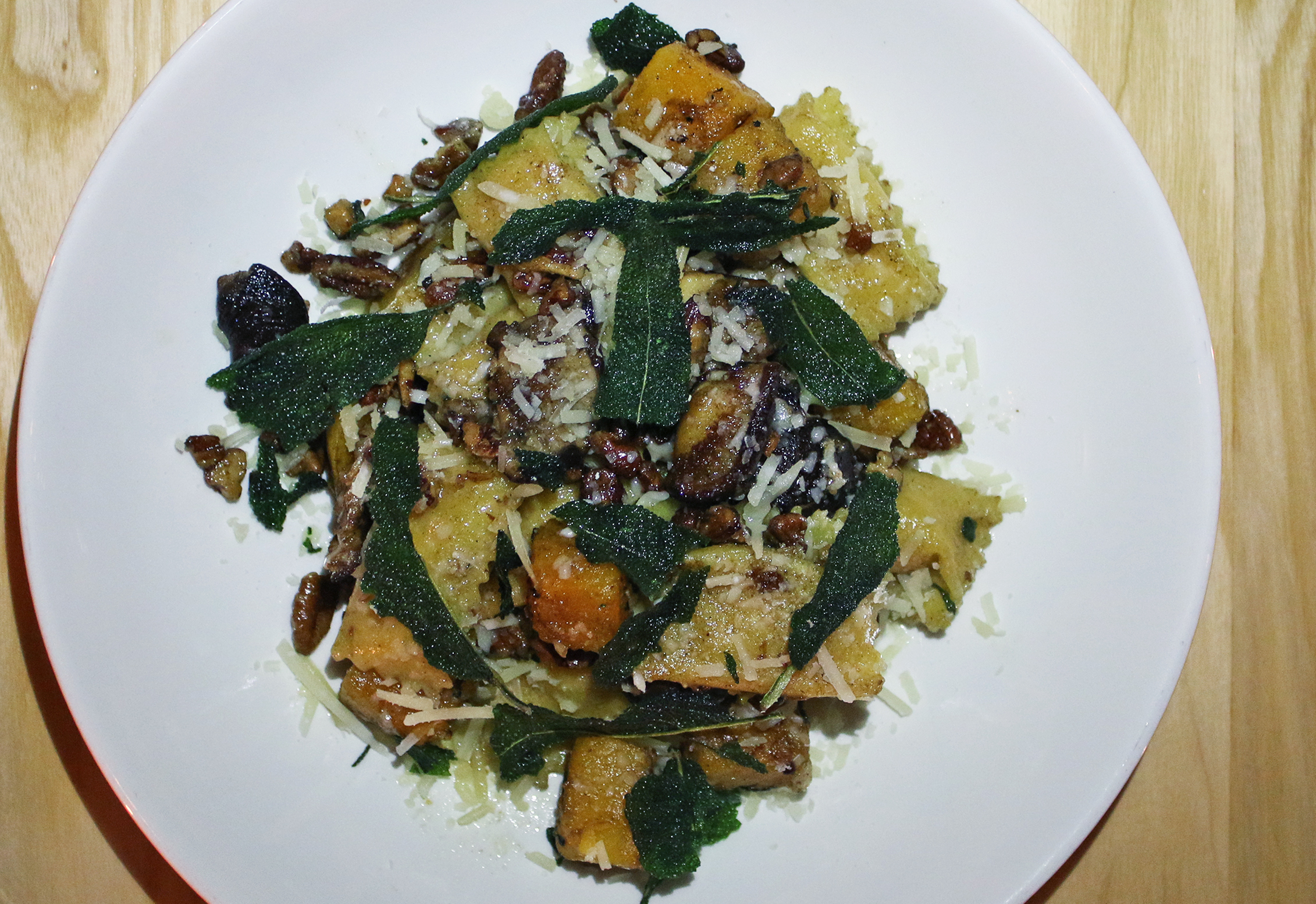 BUTTERNUT SQUASH AGNOLOTTI: sage-brown butter, shitake, pecans, grana padano