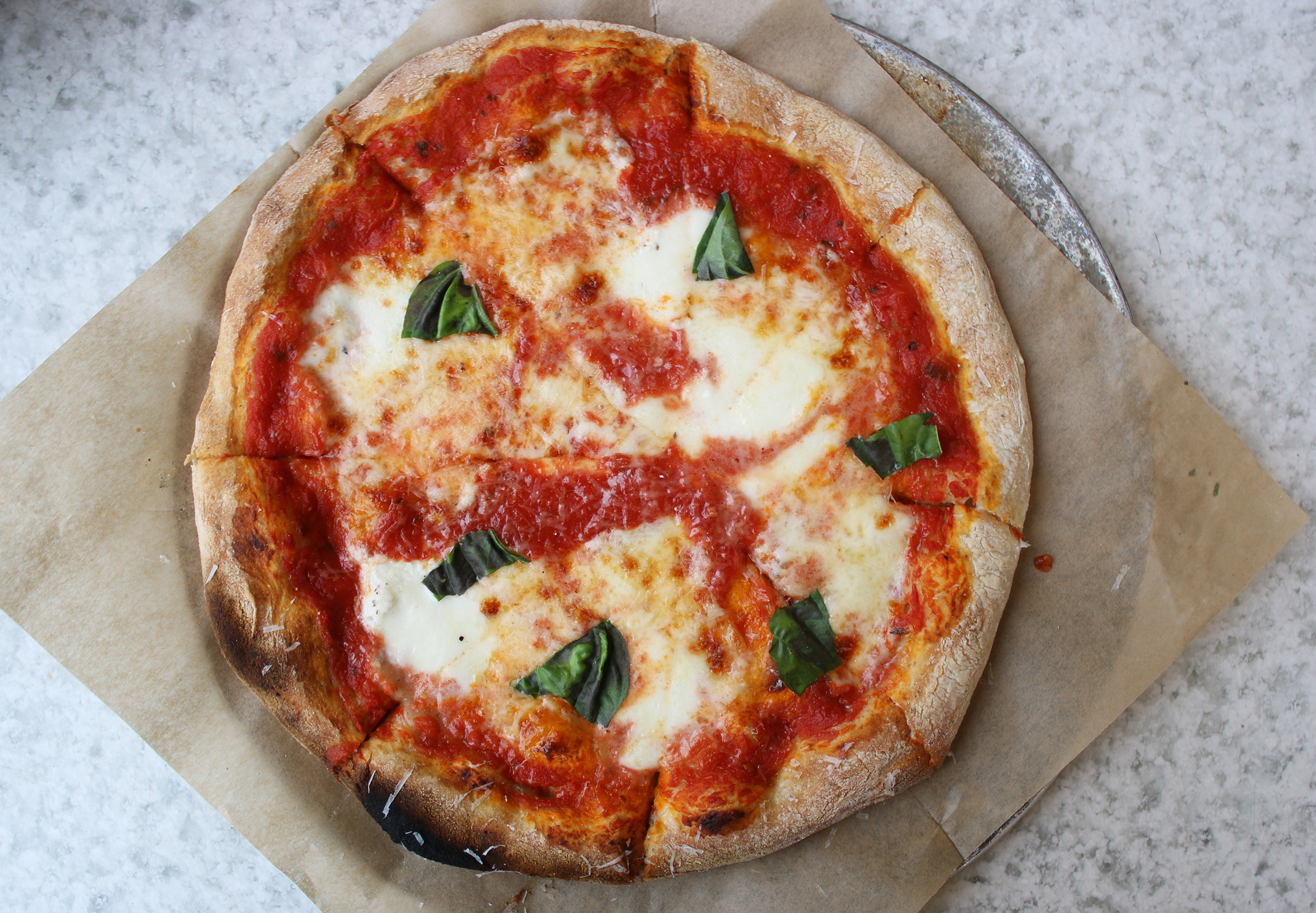 Margherita Pizza: organic DiNapoli tomato, fresh mozzarella, basil