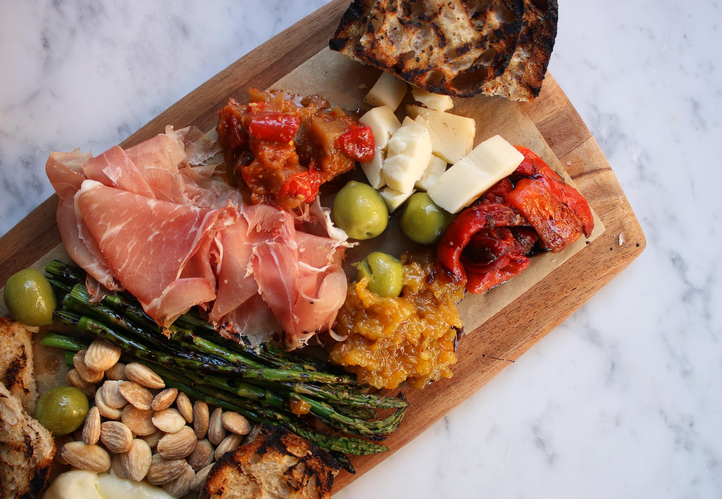 CHEF'S BOARD (serves 2-3): prosciutto di parma, artisan cheese, marinated eggplant, roasted pepper, castelvetrano olive, marcona almond