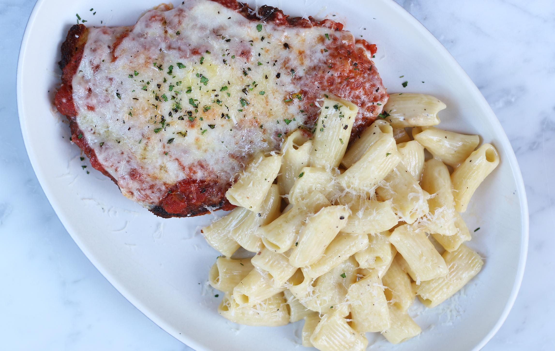 CHICKEN PARMESAN :crushed tomato, aged provolone, mozzarella, parmesan rigatoni