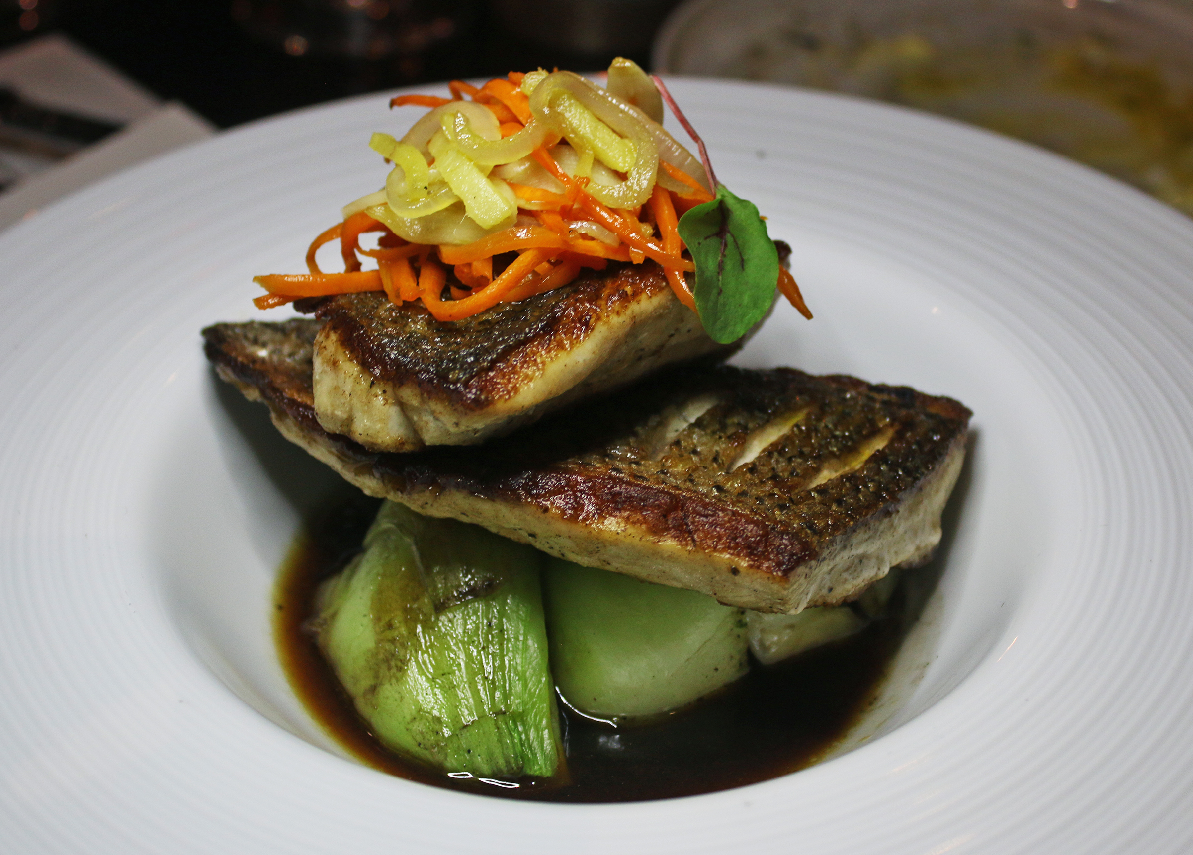 striped basswith warmed ponzu butter, ginger, garlic, bok choy and baby carrots