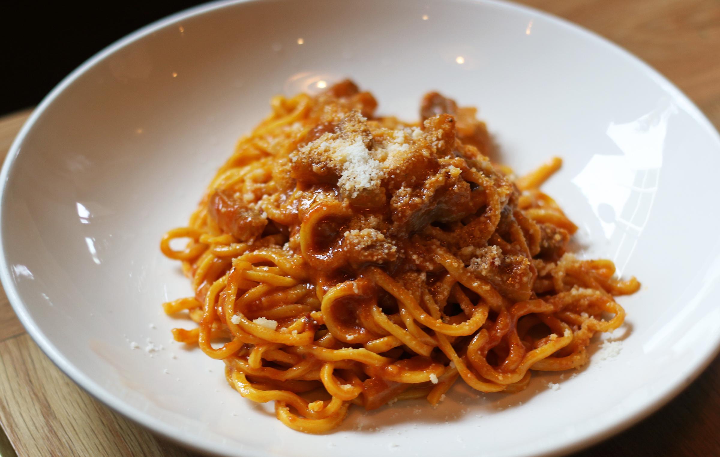 Tonnarelli all'Amatriciana:Imported tomatoes, pecorino, onion, guanciale & red chili pepper