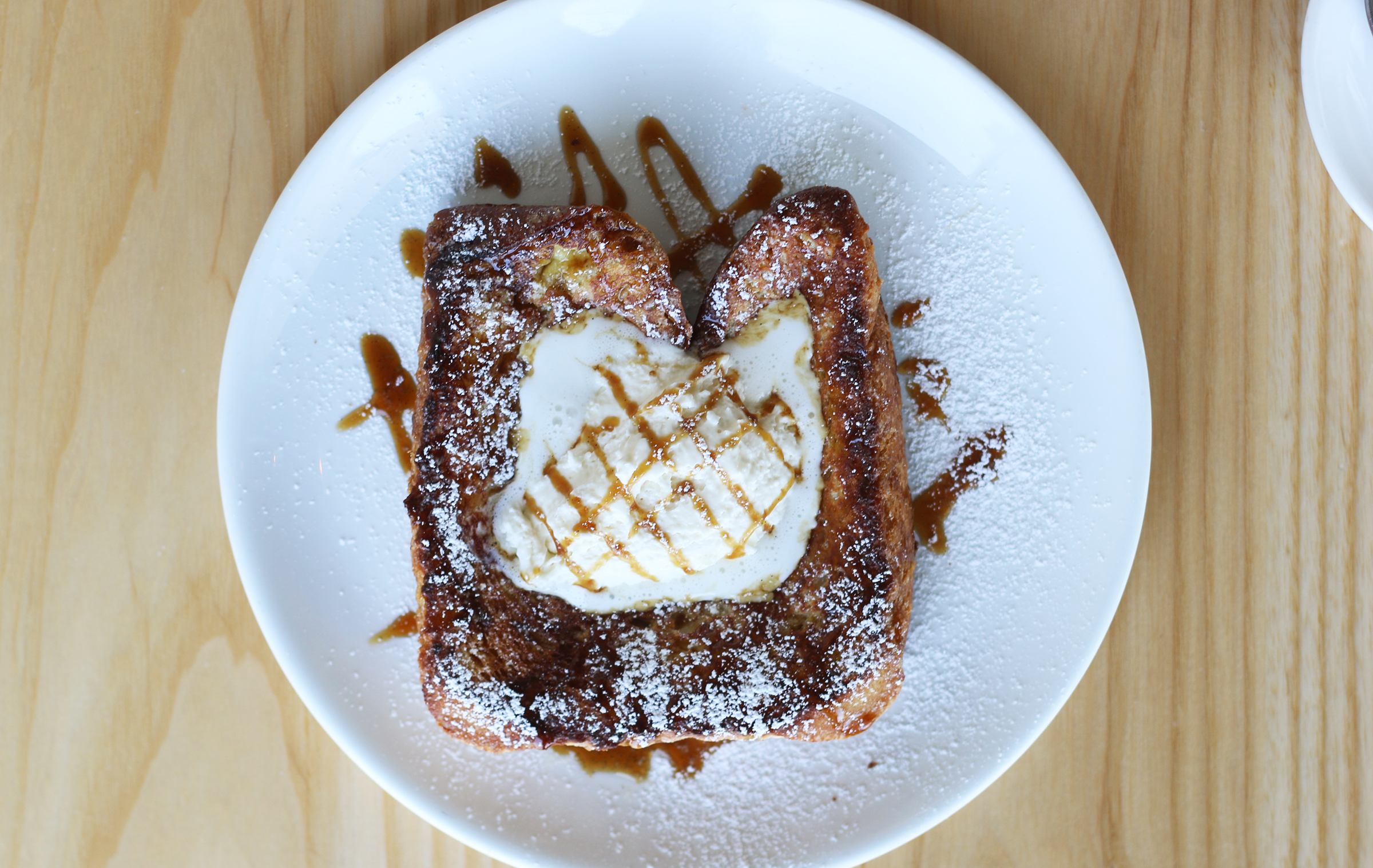 COCONUT PANDAN FRENCH TOAST macadamia nuts, crusoe rum butter, coconut chantilly cream