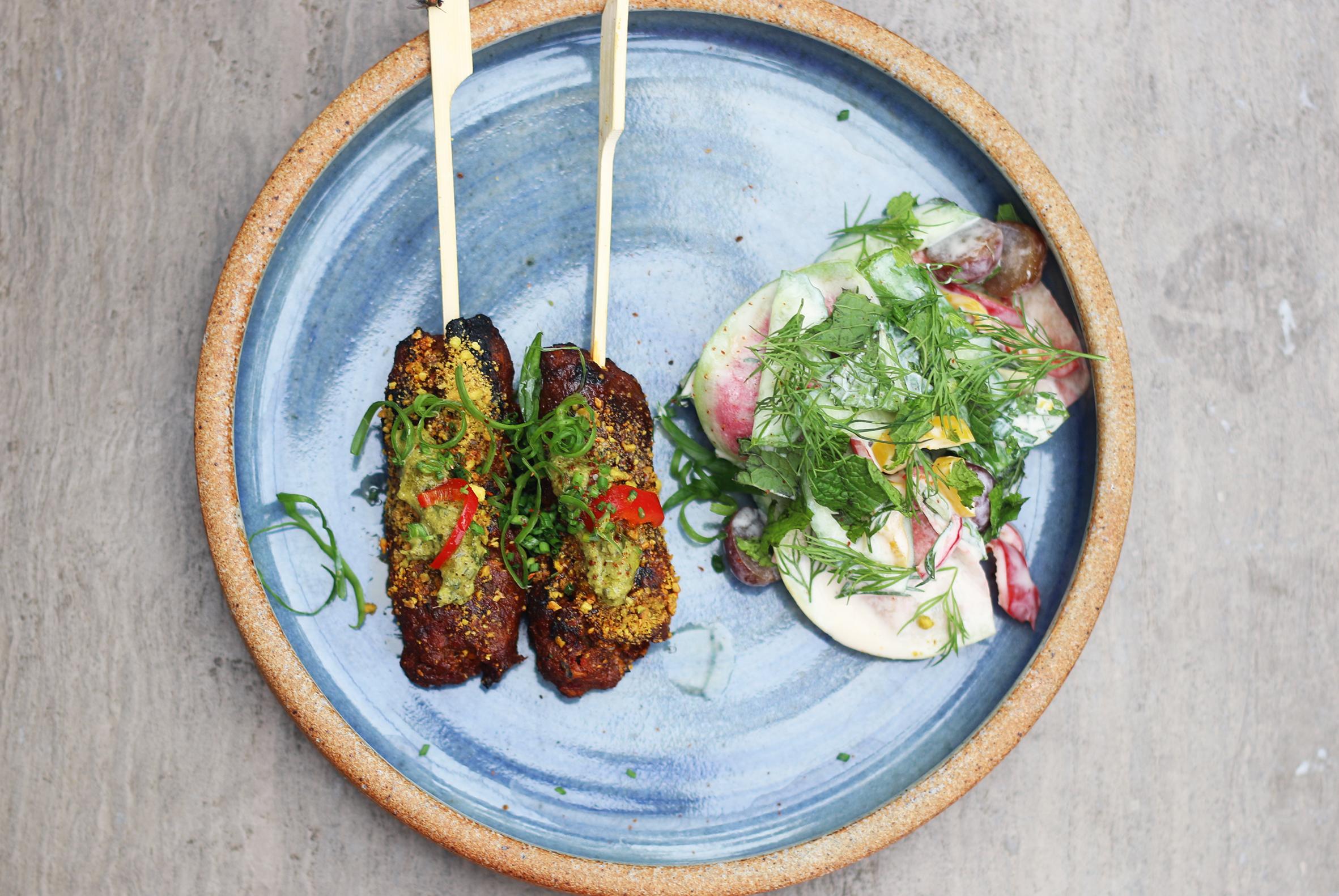 LAMB & BEEF SKEWERS:pistachio, cardamom, chili, pickled grape, curry lebni