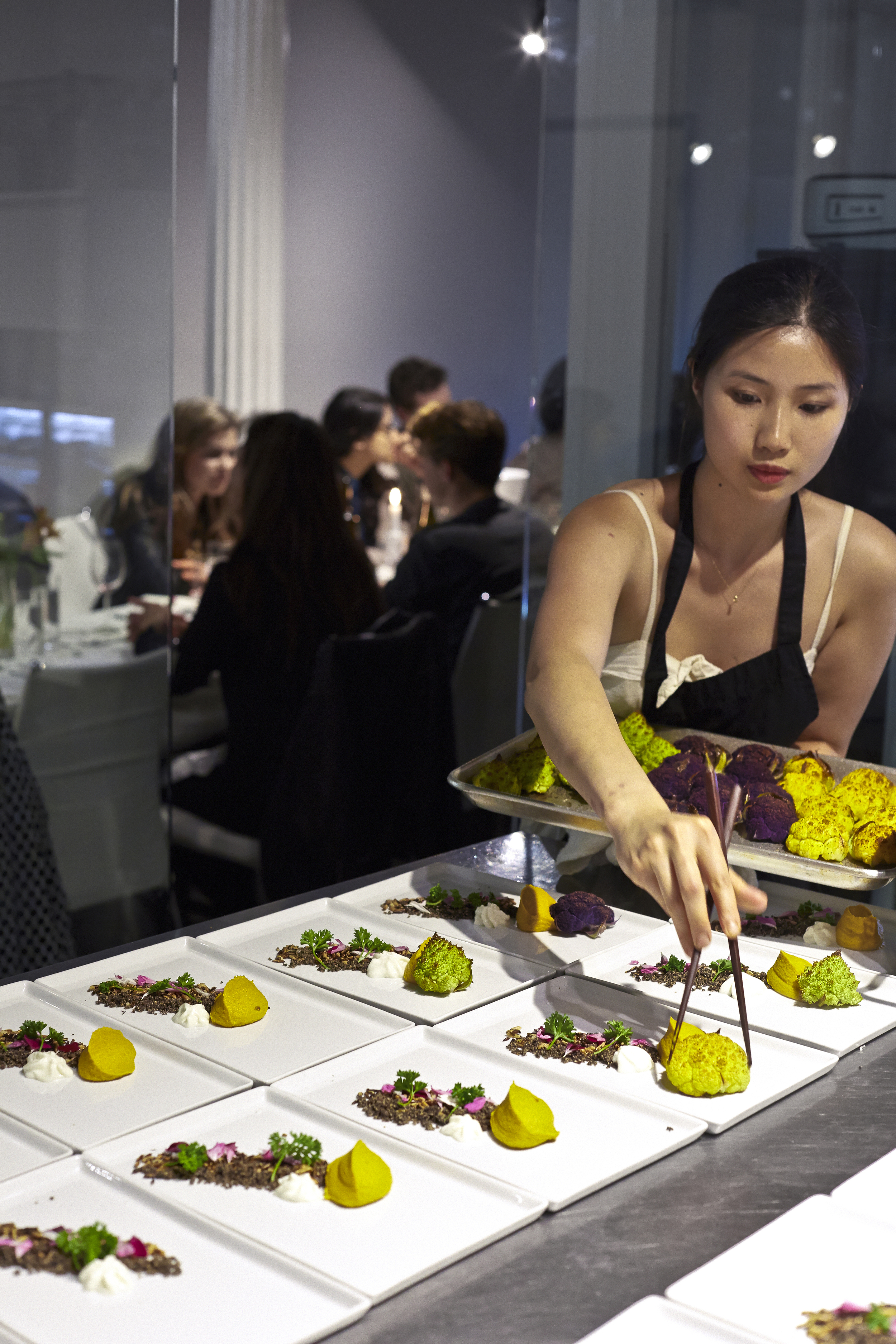 plating up dishes at Suite ThreeOhsix, Daphne's former supperclub