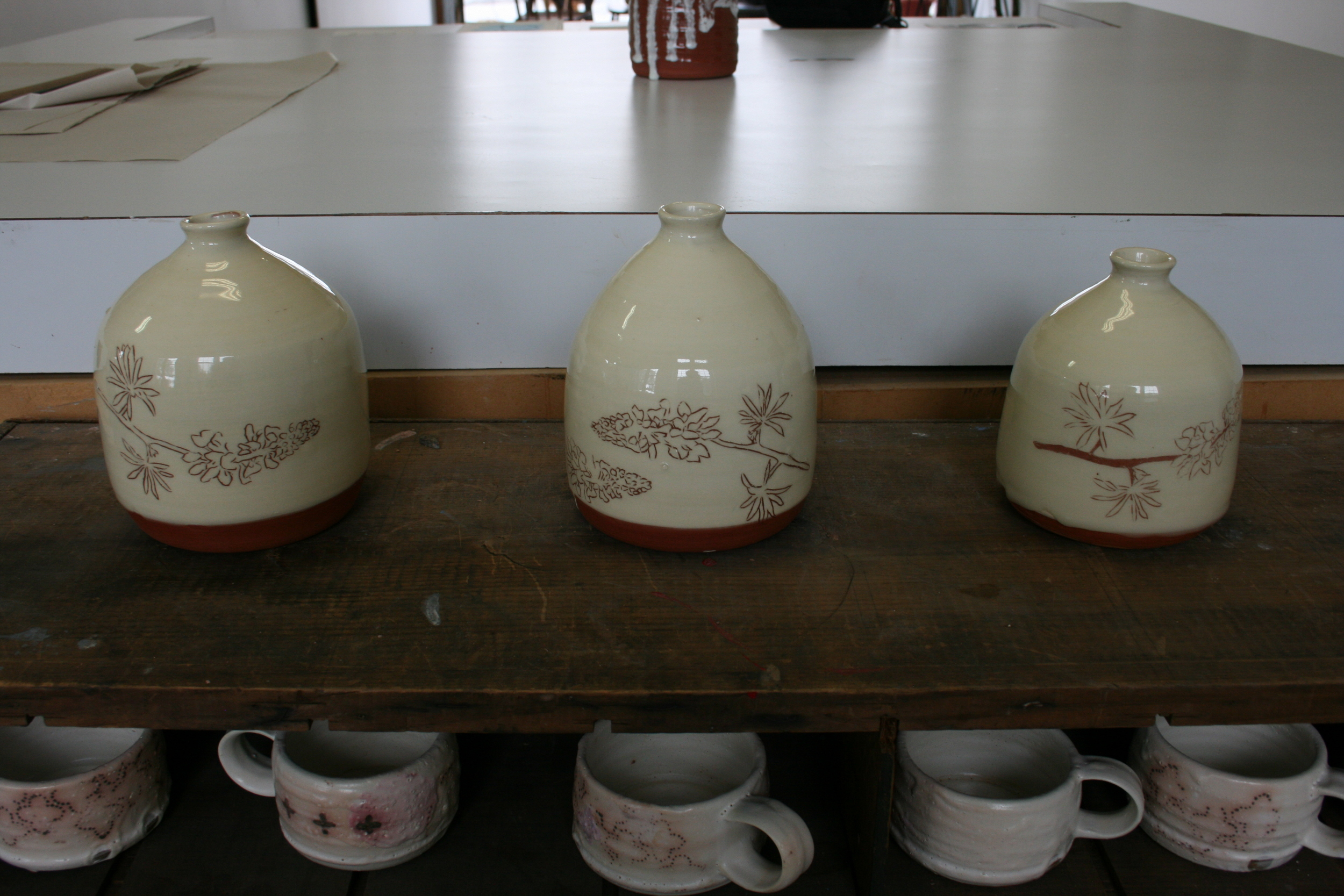 Erin and I's collaboration. Erin made these vessels and I draw the Lunenburg Lupines on them.