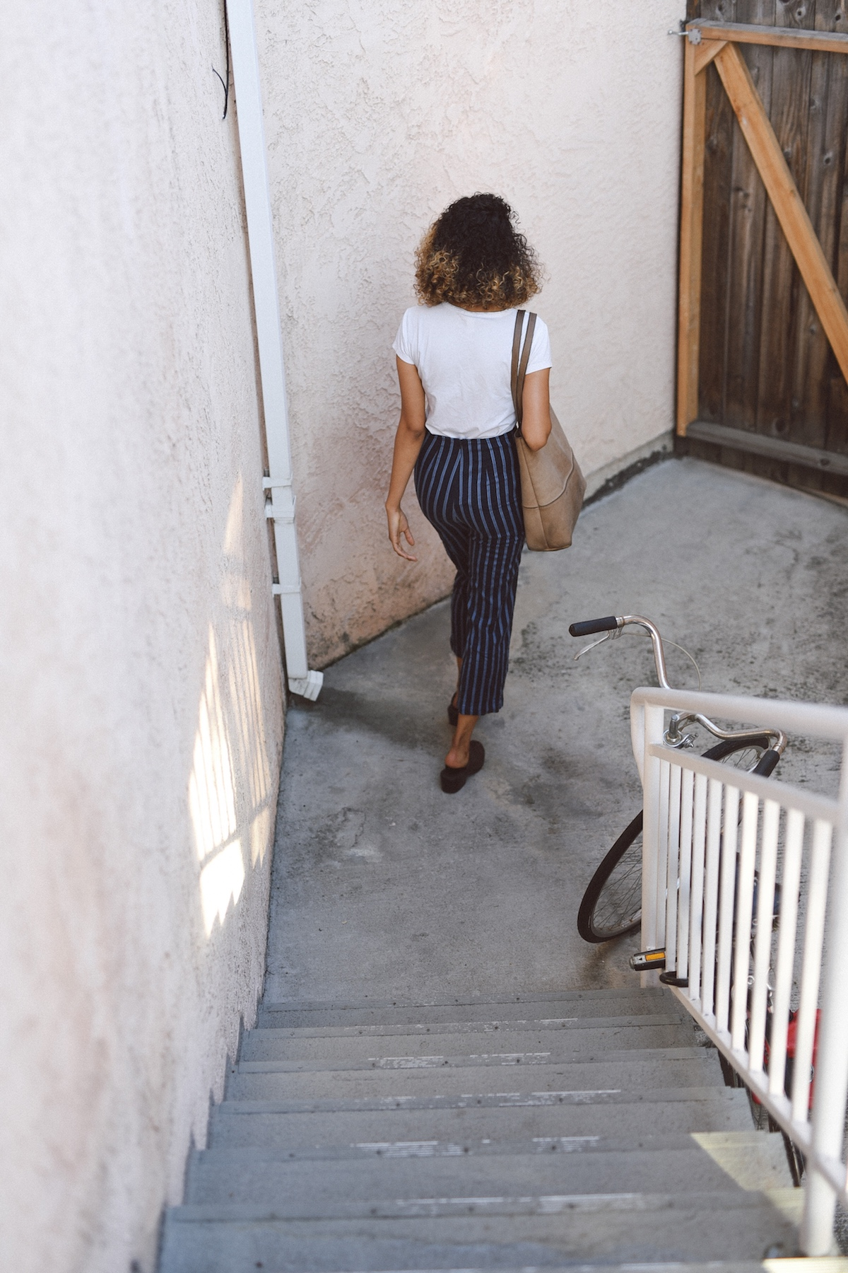 Reformation striped pants and a hobo bag  // A Week Of Outfits With Jazmine Brown on The Good Trade