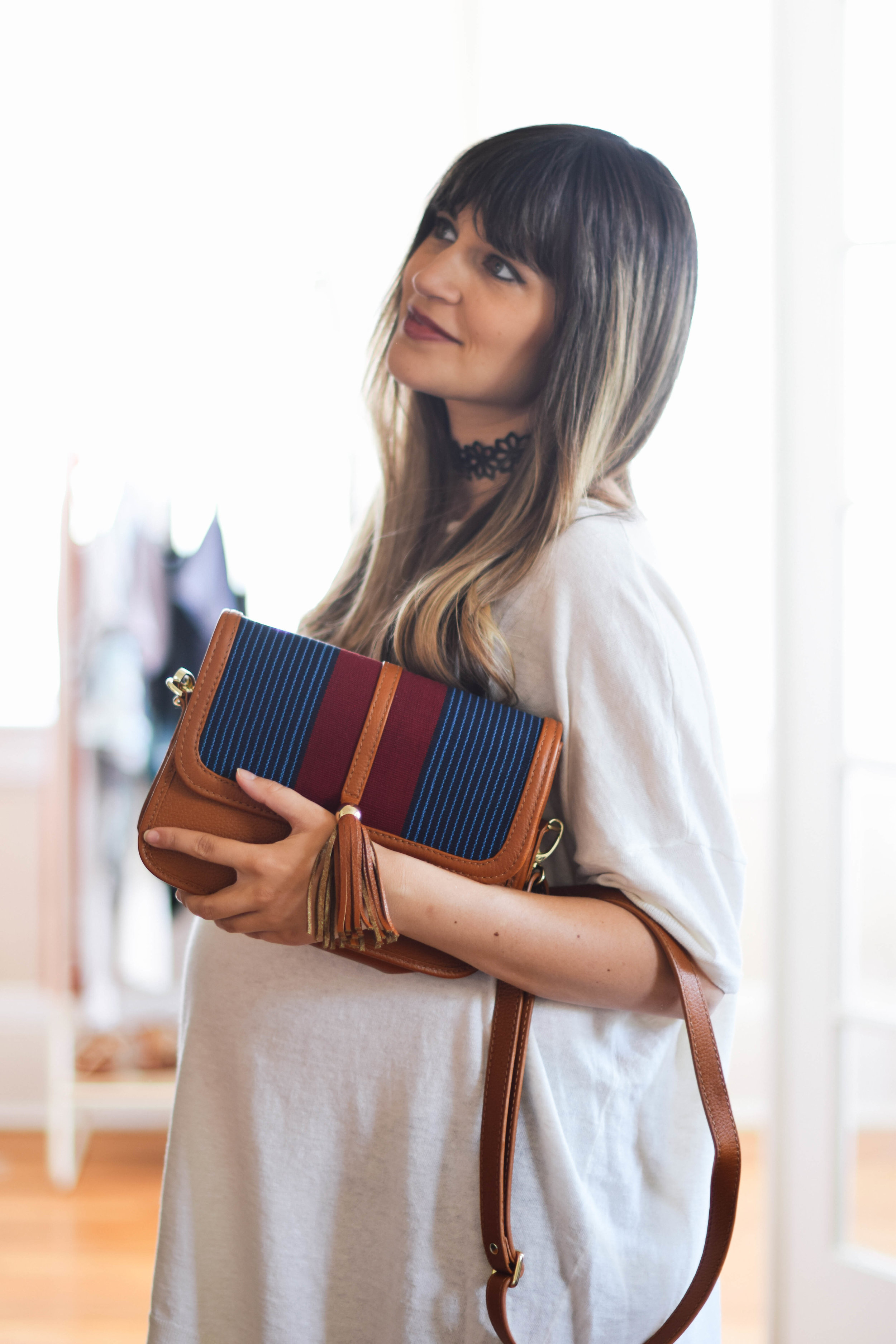 Leather and woven purse that gives back // A Week Of Sustainable Maternity Outfits With Natalie Kay Smith From Sustainably Chic on The Good Trade