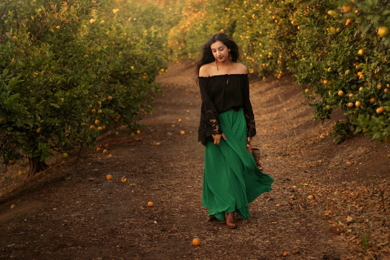 Green skirt and off the shoulder black top // A Week Of Ethical Outfits With Aditi Mayer on The Good Trade