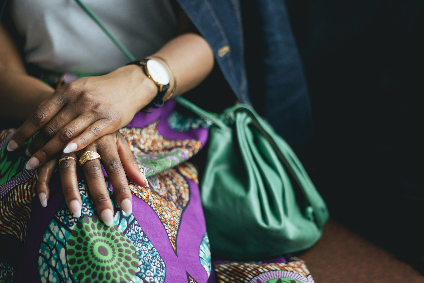 Gold jewelry with an African-print skirt designed by Kathleen // Week Of Outfits Series: A Week Of Well-Crafted & Beautiful Outfits With Kathleen Elie, Founder Of Conscious & Chic on The Good Trade
