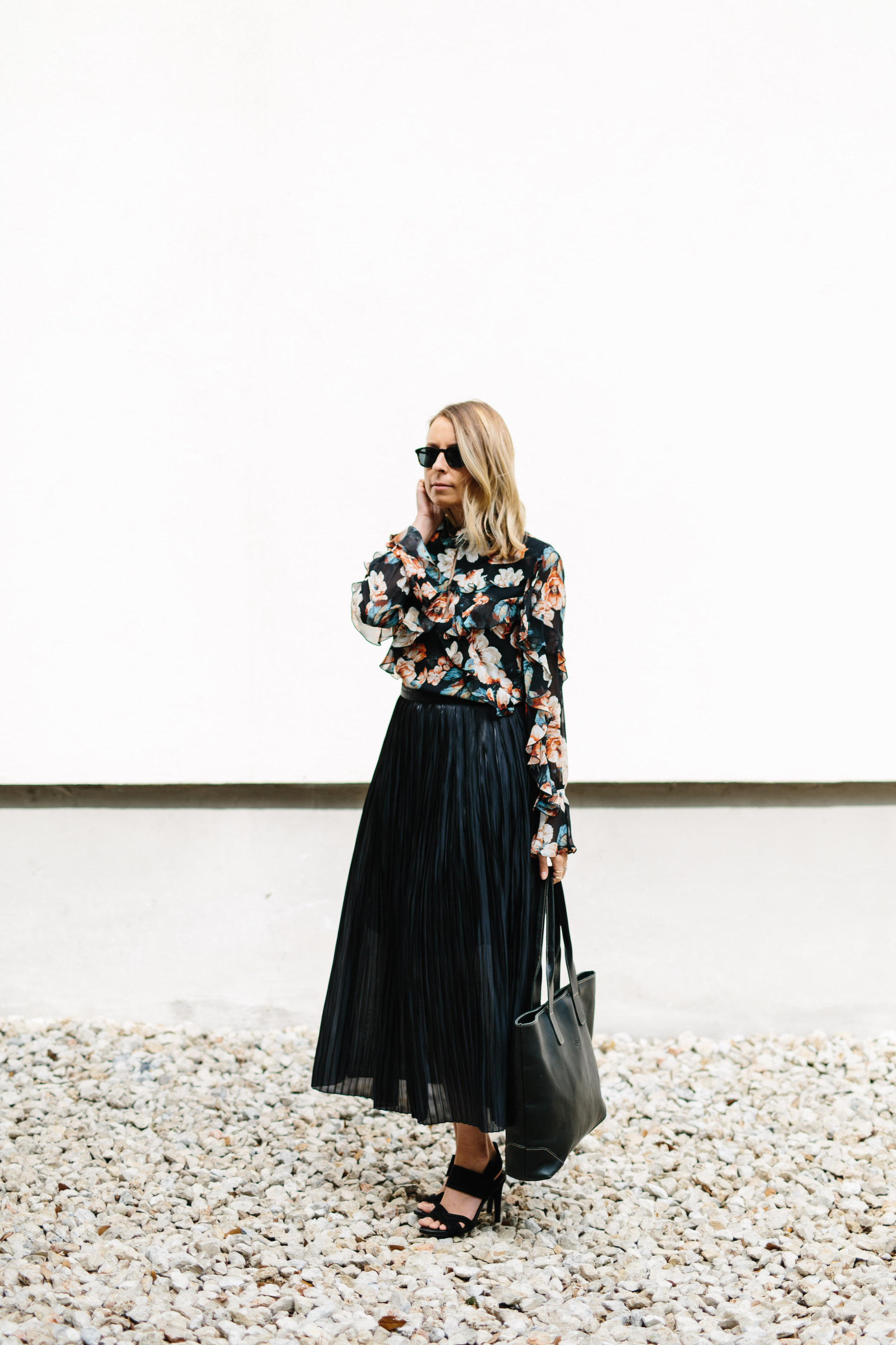Black skirt and floral top for a business meeting // A Week Of Summertime Minimalist Outfits With Ava Darnell, Founder Of Slumlove Sweater Company on The Good Trade