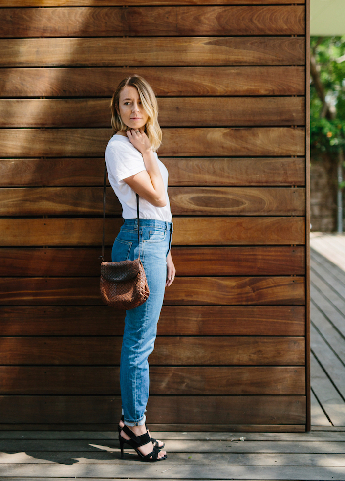 White tee and denim minimalist casual outfit // A Week Of Summertime Minimalist Outfits With Ava Darnell, Founder Of Slumlove Sweater Company on The Good Trade