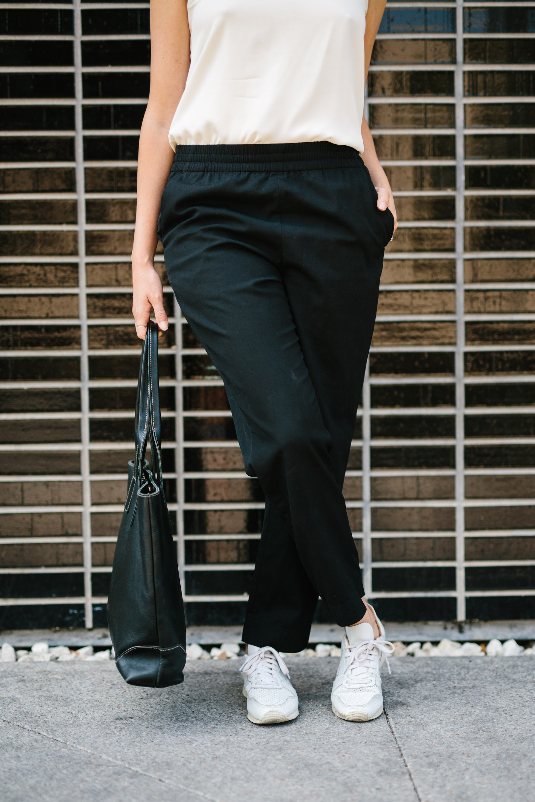 Artisan leather bag with a monochrome outfit // A Week Of Summertime Minimalist Outfits With Ava Darnell, Founder Of Slumlove Sweater Company on The Good Trade
