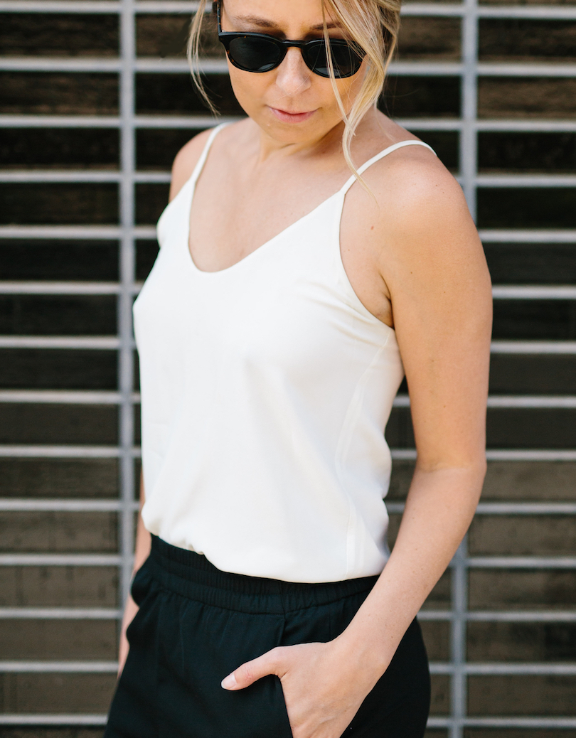White tank and black pants with Warby Parker sunglasses // A Week Of Summertime Minimalist Outfits With Ava Darnell, Founder Of Slumlove Sweater Company on The Good Trade