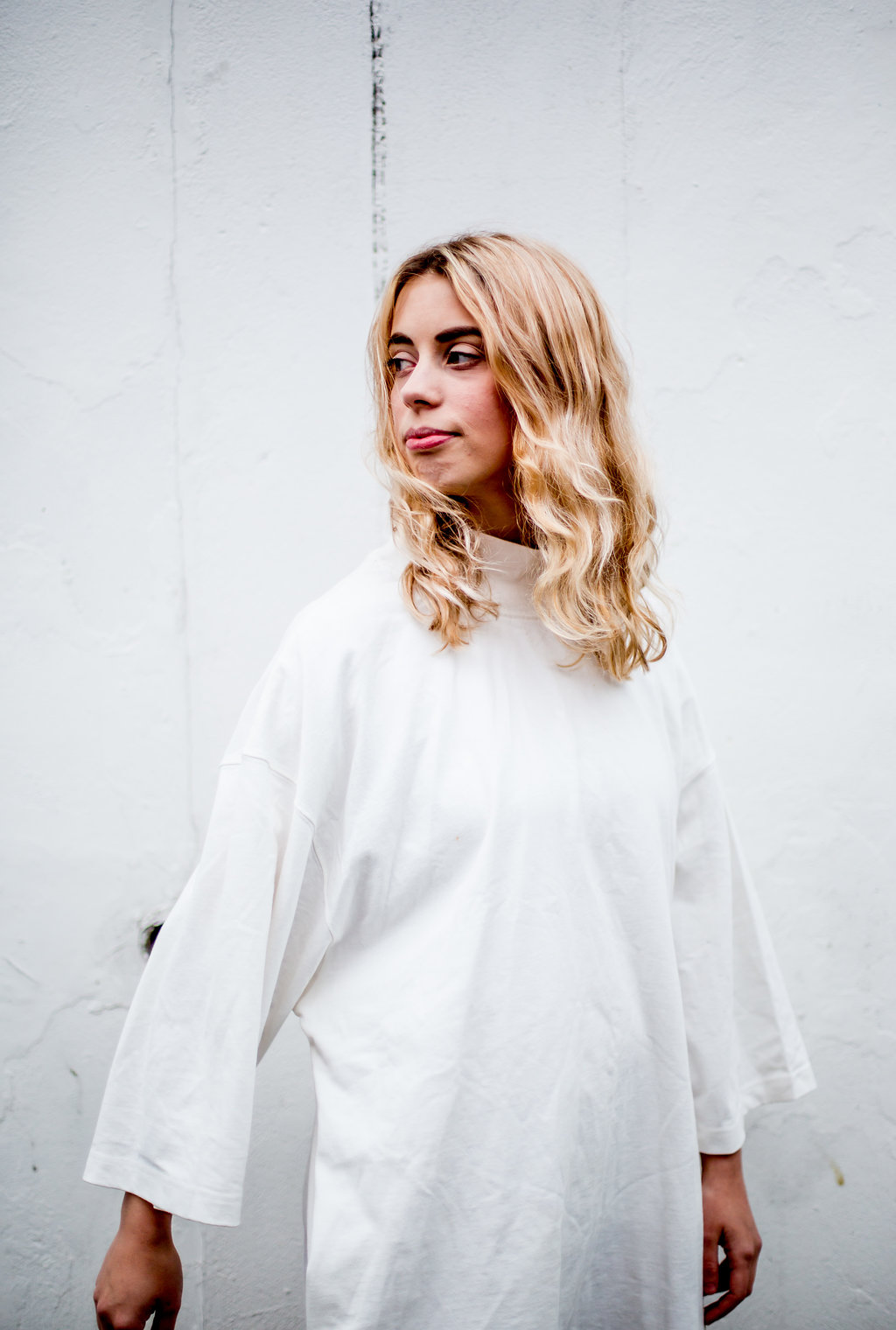 White mockneck casual dress // A Week Of Vibrant & Global Outfits With Francesca Willow From Ethical Unicorn on The Good Trade