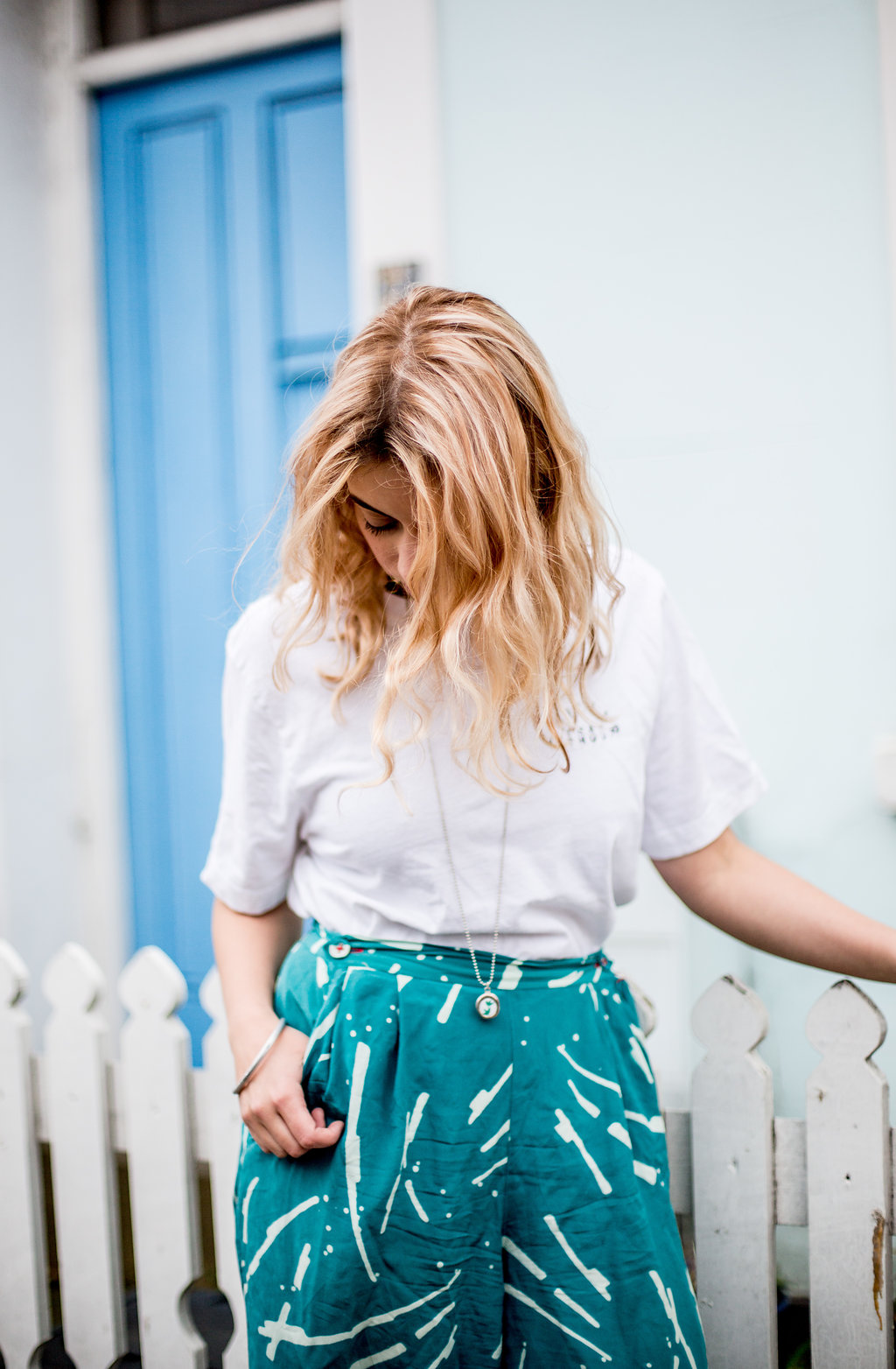 Bold, artistic teal pants with a neutral tee  // A Week Of Vibrant & Global Outfits With Francesca Willow From Ethical Unicorn on The Good Trade