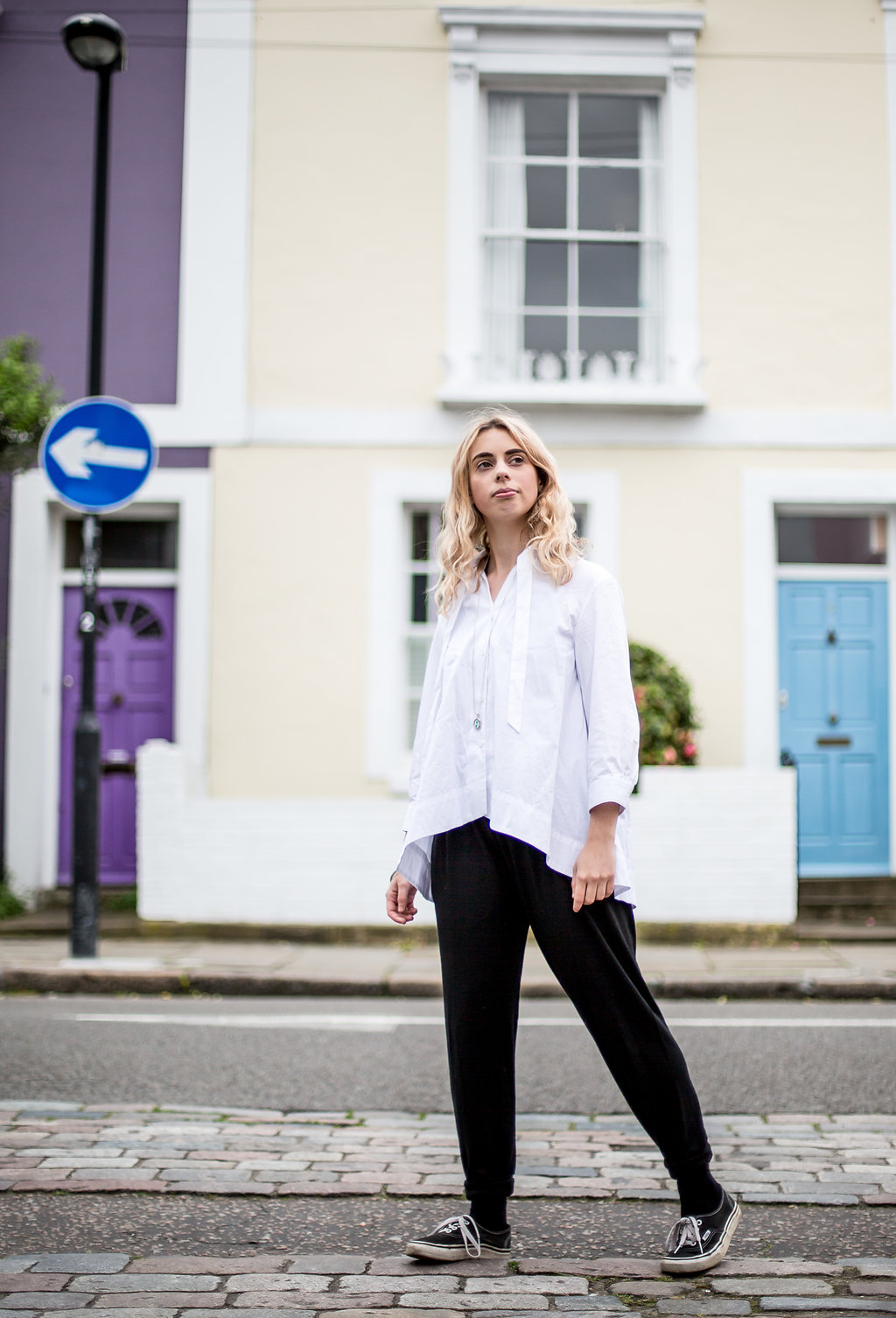 Crisp white blouse with joggers for a casual look // A Week Of Vibrant & Global Outfits With Francesca Willow From Ethical Unicorn on The Good Trade
