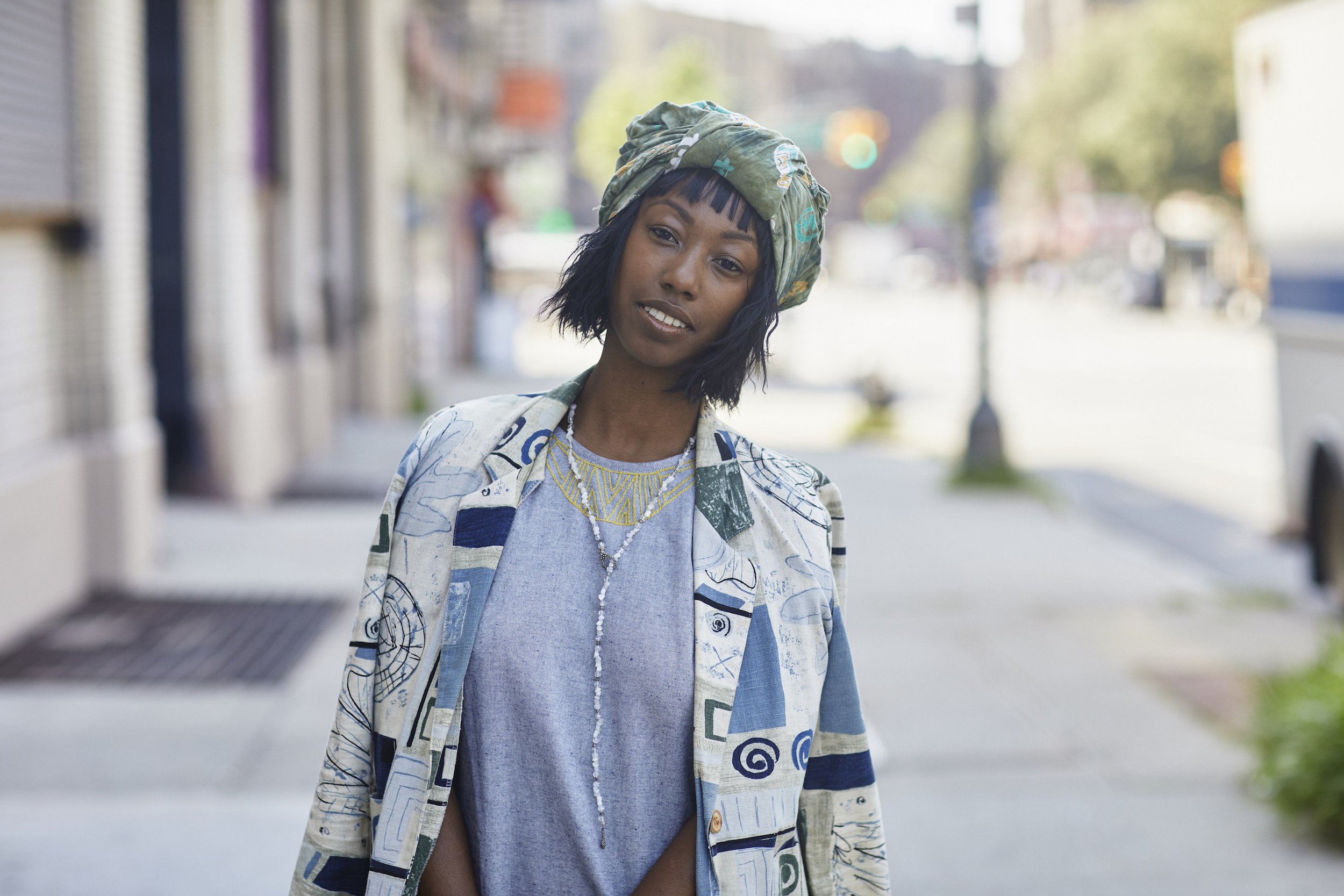 Chic blue-toned outfit with green headwrap // A Week Of Outfits With Dominique Drakeford, Founder Of Melanin & Sustainable Style on The Good Trade