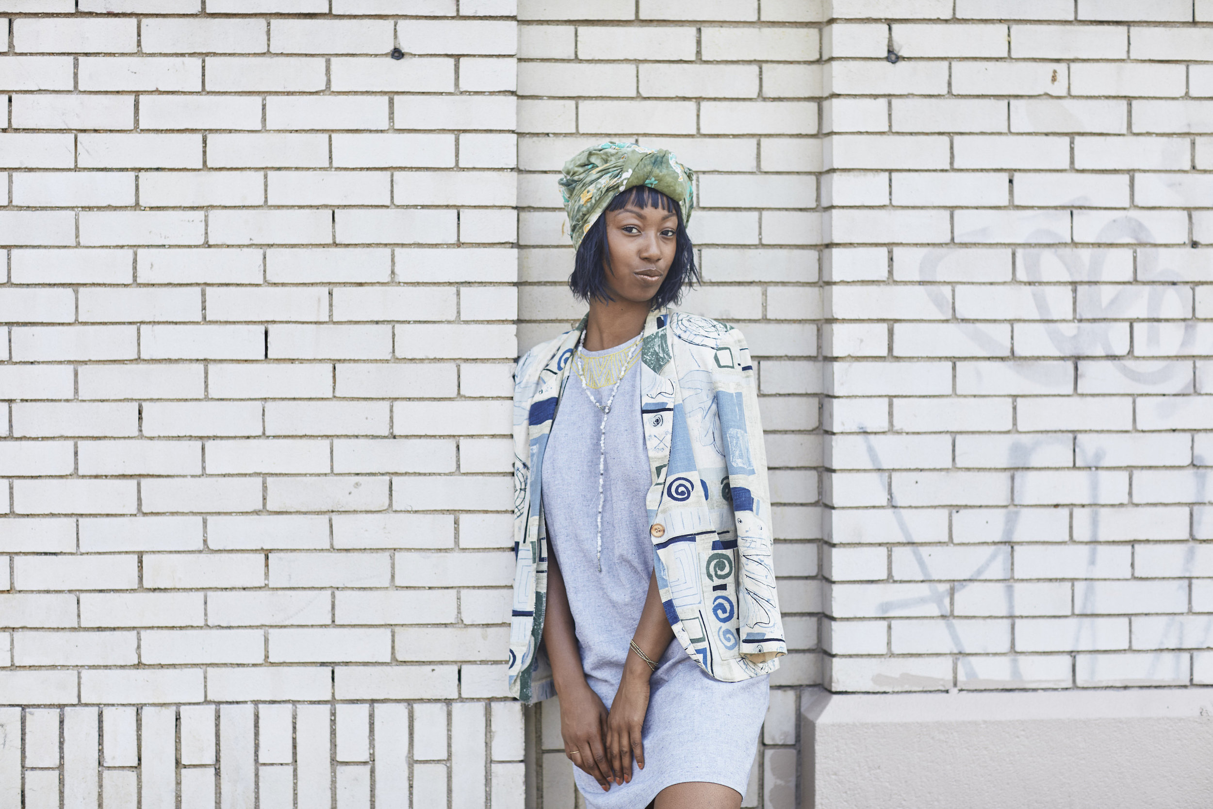 Shift dress with thrifted patterned blazer // A Week Of Outfits With Dominique Drakeford, Founder Of Melanin & Sustainable Style on The Good Trade