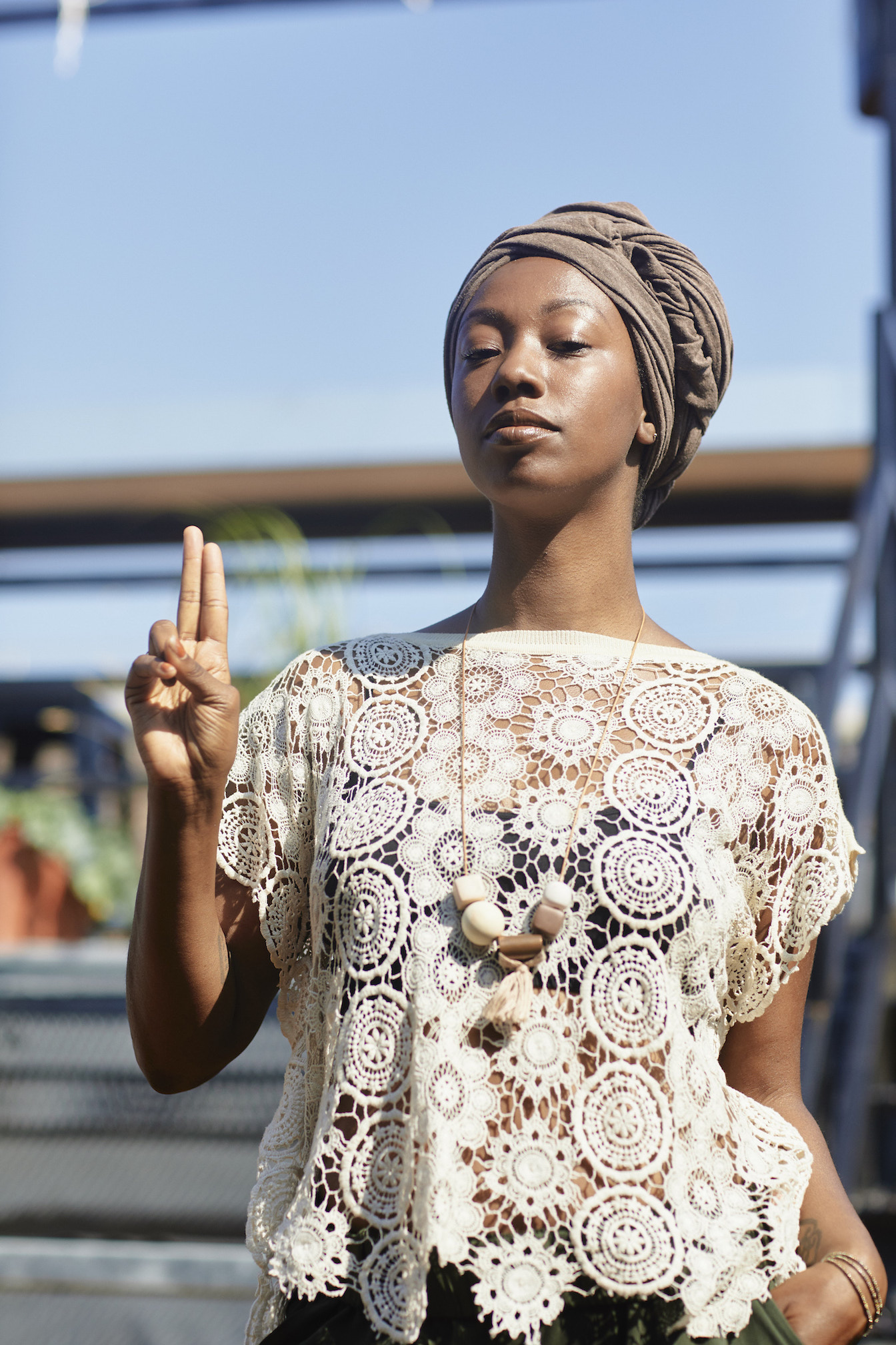Lace top and brown headwrap casual outfit // A Week Of Outfits With Dominique Drakeford, Founder Of Melanin & Sustainable Style on The Good Trade