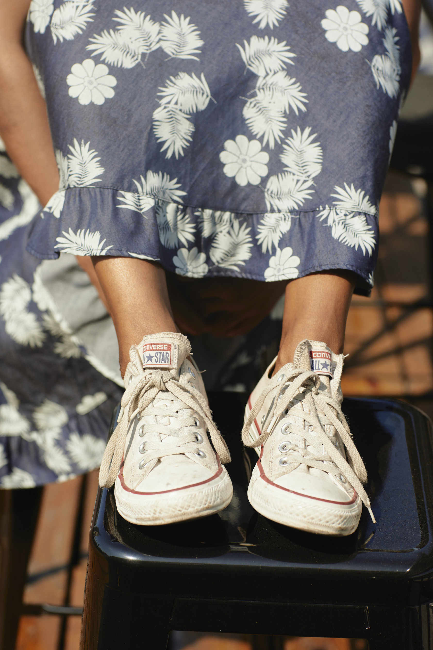Converse sneakers with a feminine dress // A Week Of Outfits With Dominique Drakeford, Founder Of Melanin & Sustainable Style on The Good Trade