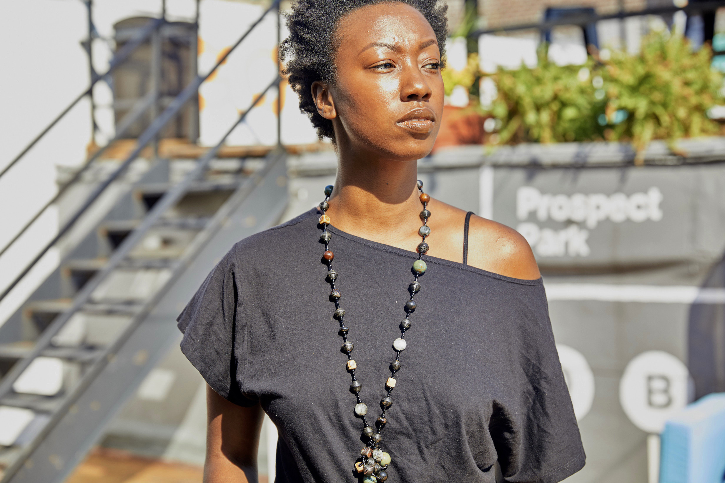 Box tee and Urban Zen necklace // A Week Of Outfits With Dominique Drakeford, Founder Of Melanin & Sustainable Style on The Good Trade