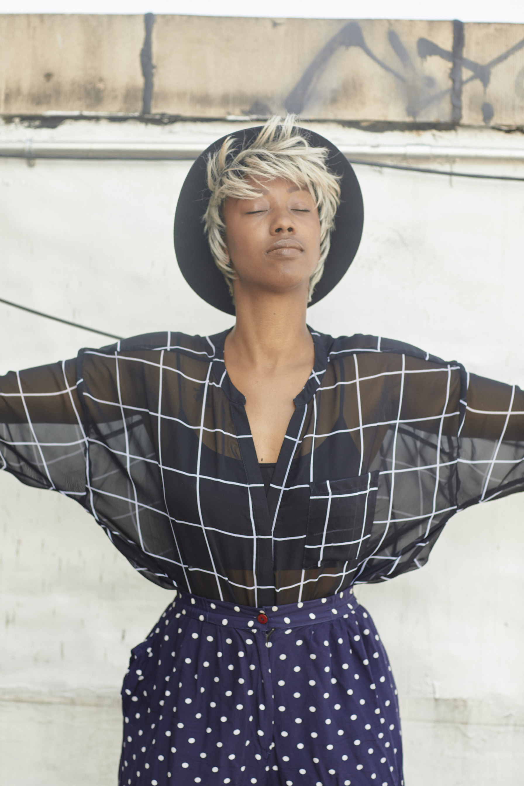 Pattern mixing with a sheer top and high waist pants // A Week Of Outfits With Dominique Drakeford, Founder Of Melanin & Sustainable Style on The Good Trade