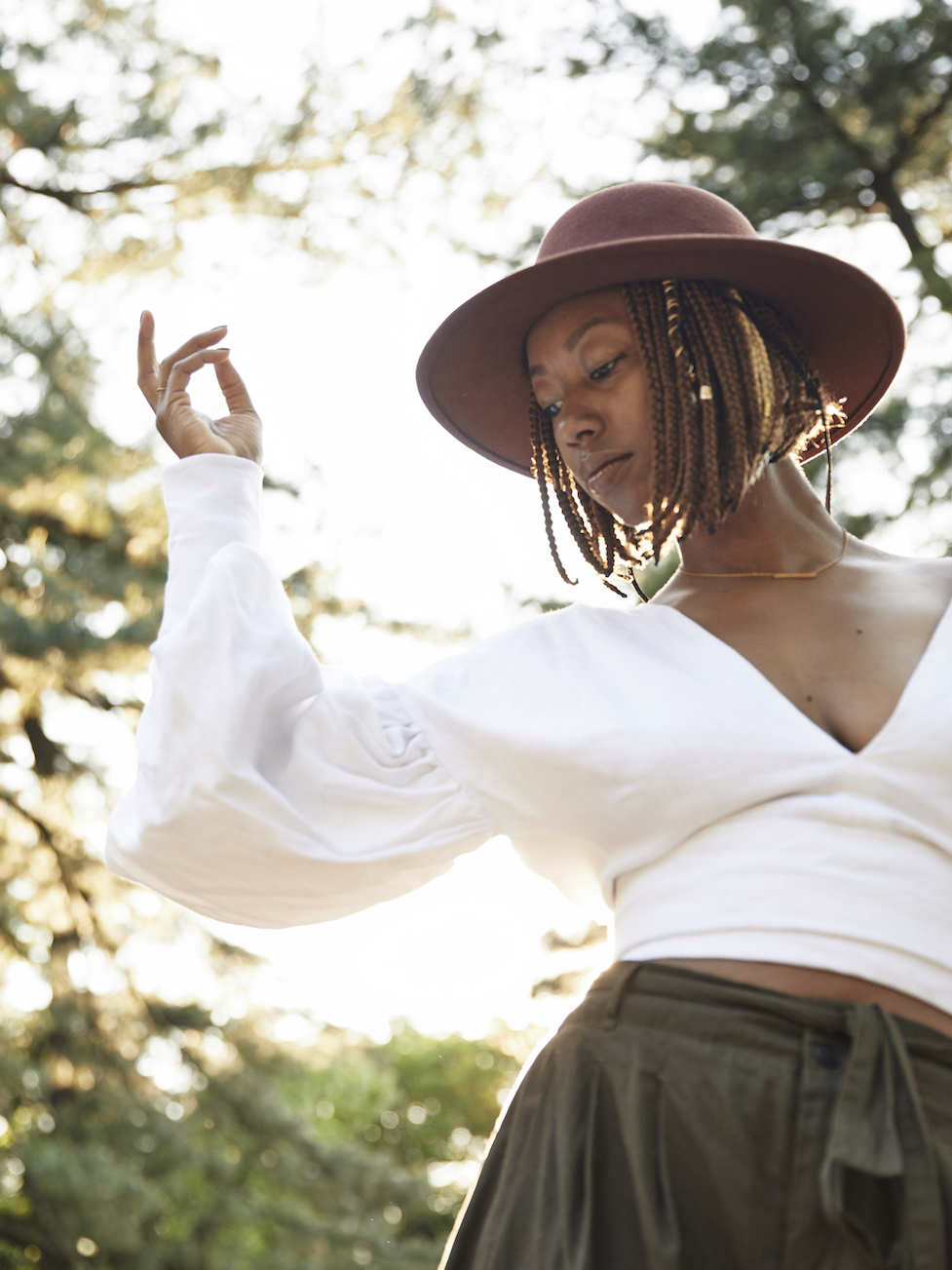 Statement bell sleeves on a white top // A Week Of Outfits With Dominique Drakeford, Founder Of Melanin & Sustainable Style on The Good Trade