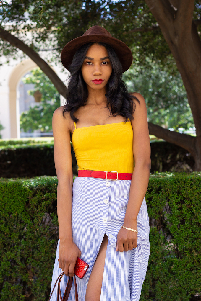 Colorful summer outfit with a cute hat // A Week Of Hollywood-Inspired Outfits With Conscious Style Blogger Jeneice Thompson on The Good Trade