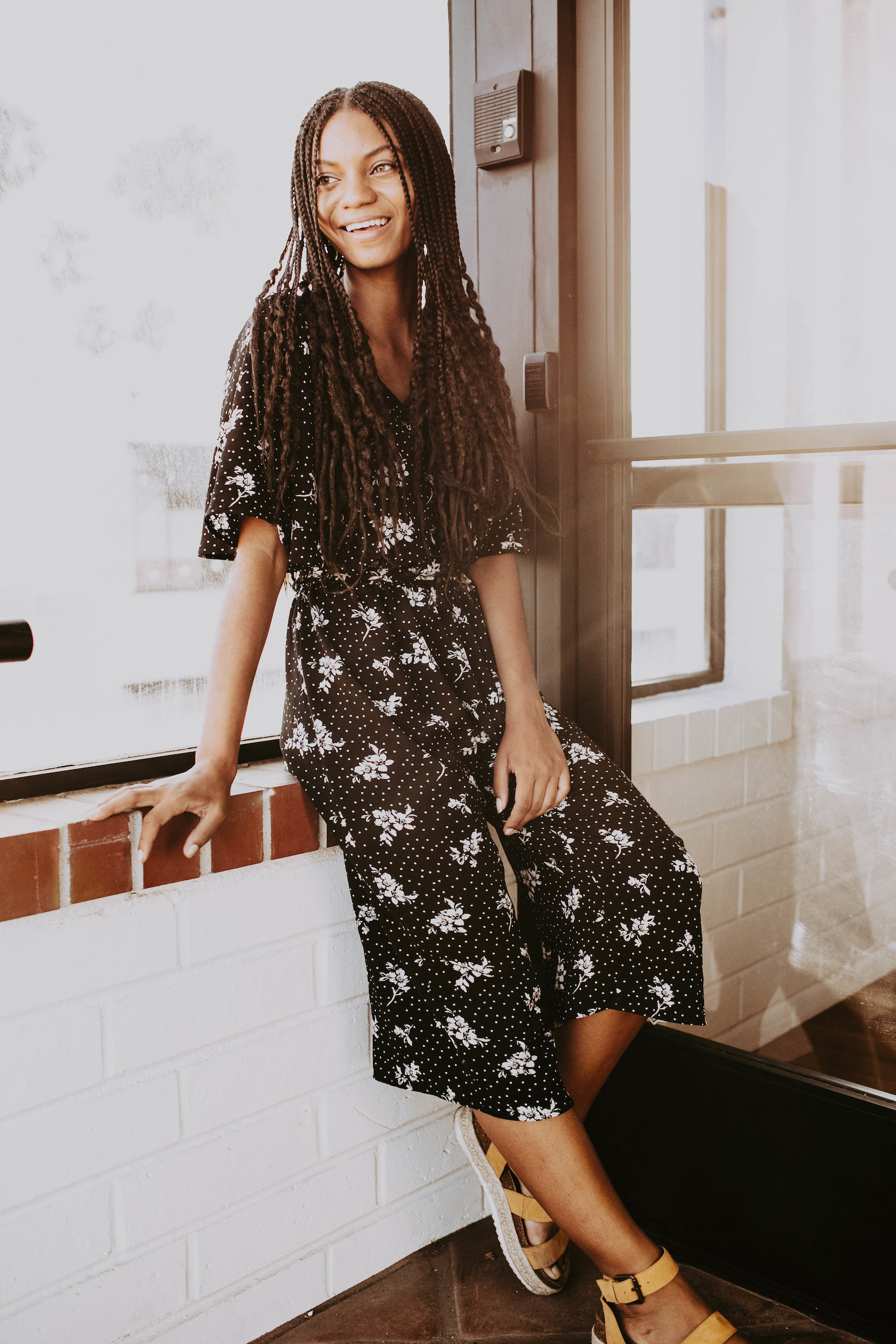Thrifted black and white floral jumpsuit with modern sandals // A Week Of 1970s-Inspired Outfits With Leah Thomas, The Sustainable Lifestyle Blogger Behind Green Girl Leah on The Good Trade