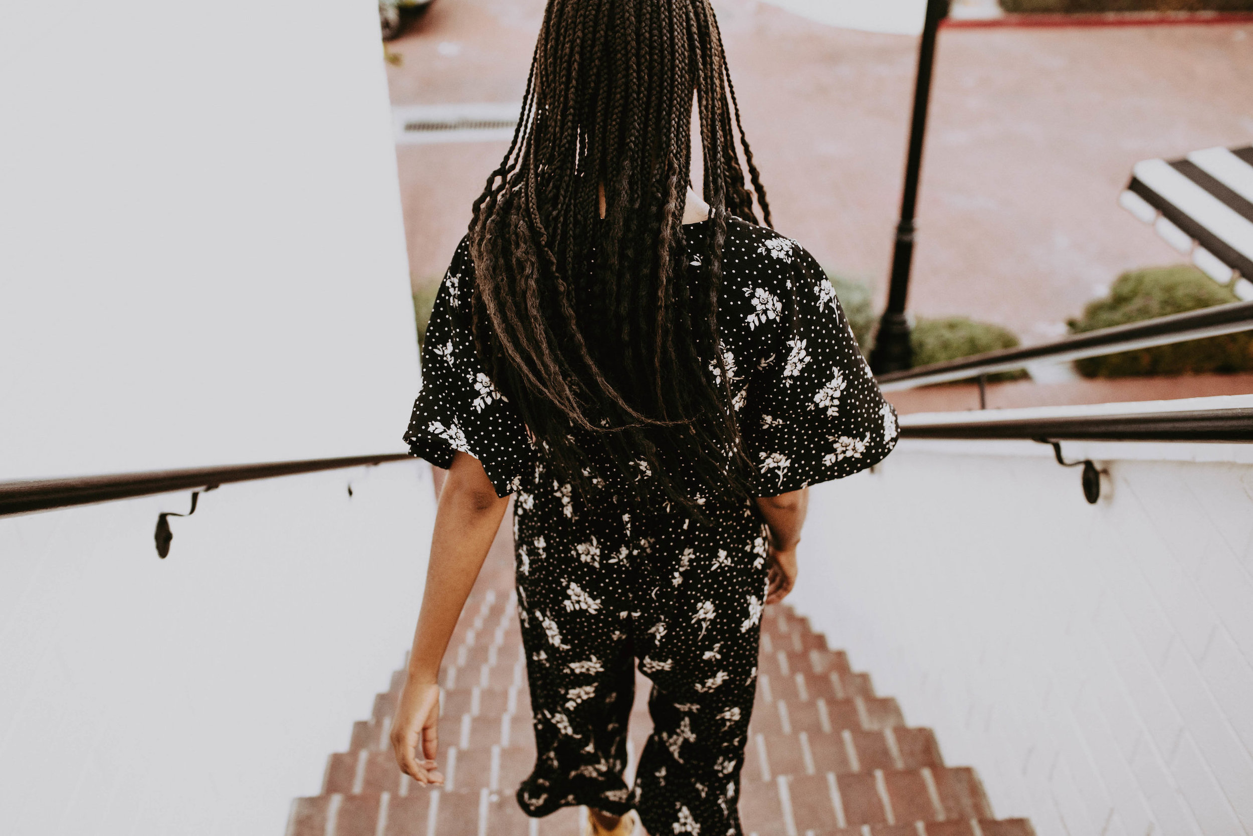 Black and white thrifted jumpsuit // A Week Of 1970s-Inspired Outfits With Leah Thomas, The Sustainable Lifestyle Blogger Behind Green Girl Leah on The Good Trade