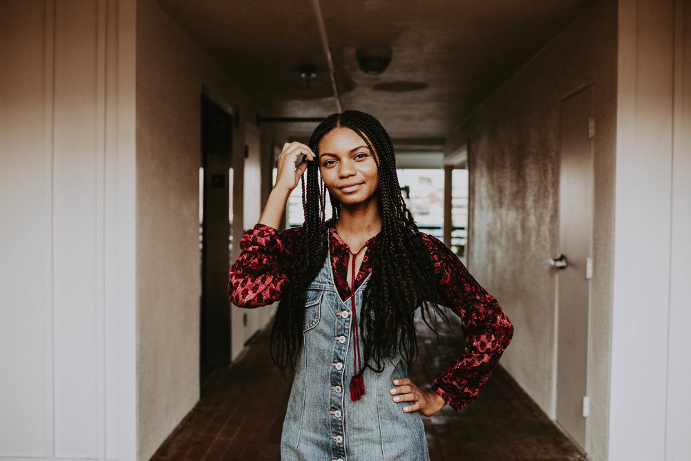 70s inspired fashion with denim dress // A Week Of 1970s-Inspired Outfits With Leah Thomas, The Sustainable Lifestyle Blogger Behind Green Girl Leah on The Good Trade