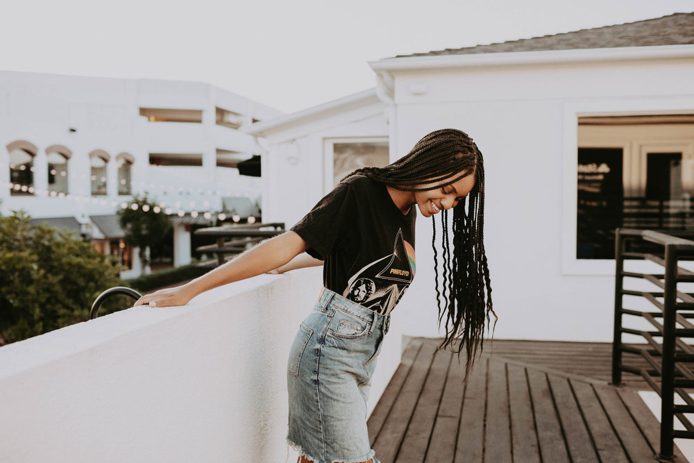 Pink Floyd vintage t-shirt with denim skirt // A Week Of 1970s-Inspired Outfits With Leah Thomas, The Sustainable Lifestyle Blogger Behind Green Girl Leah on The Good Trade