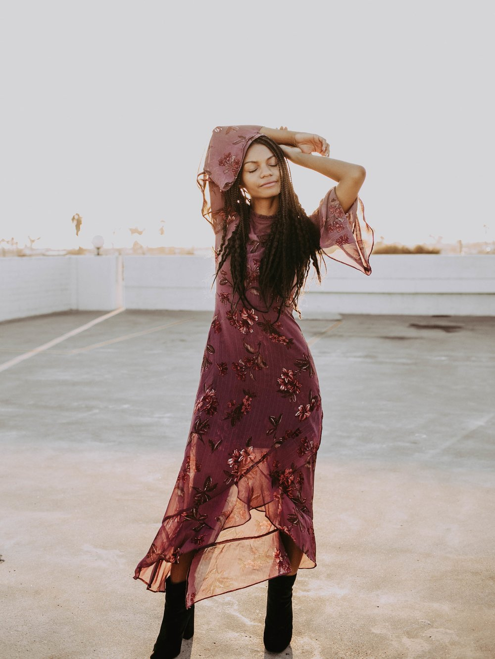 Thrifted red floral dress by Jolt // A Week Of 1970s-Inspired Outfits With Leah Thomas, The Sustainable Lifestyle Blogger Behind Green Girl Leah on The Good Trade