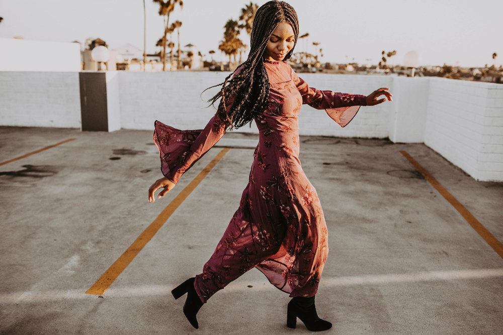Long red dress with black booties for fall  // A Week Of 1970s-Inspired Outfits With Leah Thomas, The Sustainable Lifestyle Blogger Behind Green Girl Leah on The Good Trade