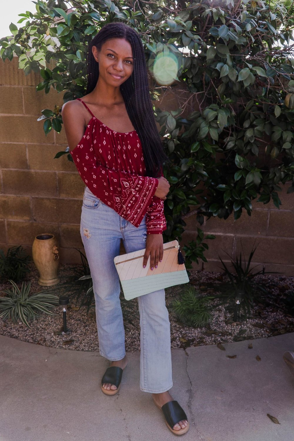 Cute peasant top and thrifted jeans // A Week Of 1970s-Inspired Outfits With Leah Thomas, The Sustainable Lifestyle Blogger Behind Green Girl Leah on The Good Trade