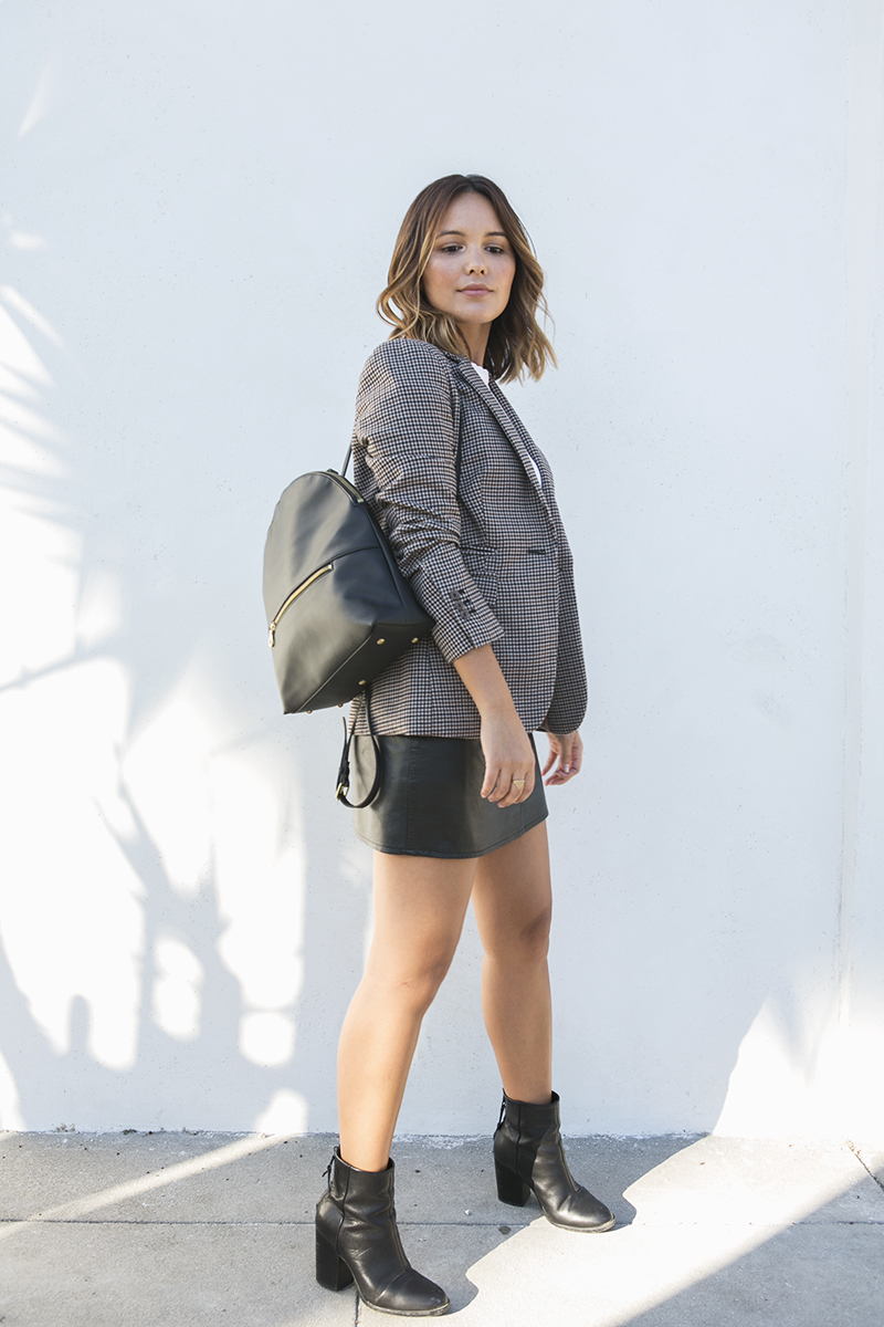 Checkered blazer and mini skirt with vegan boots // A Week Of Intentional & Sustainable Outfits With Kasha Cabato From Green With Style on The Good Trade