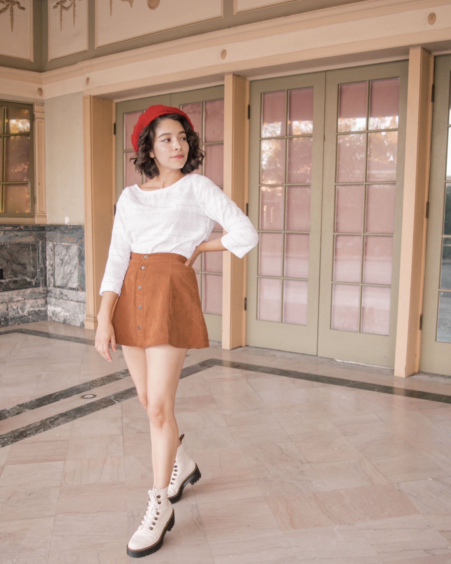 Mini skirt with Dr. Martens combat boots outfit // A Week Of Self-Expressive Outfits With Aja Duran From Aja With Love on The Good Trade
