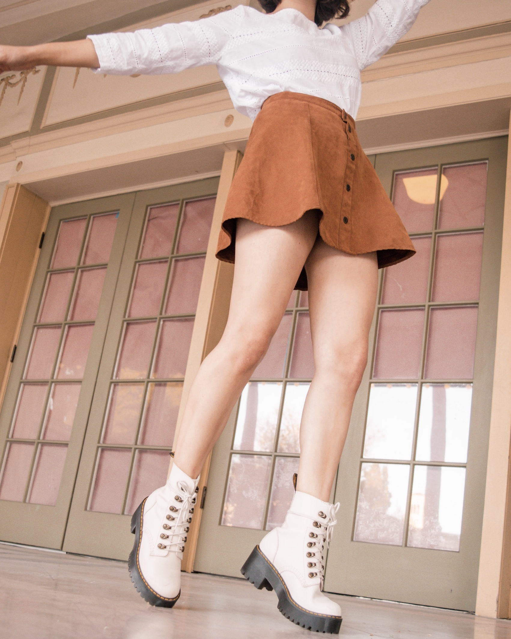Camel brown mini skirt with white shirt // A Week Of Self-Expressive Outfits With Aja Duran From Aja With Love on The Good Trade
