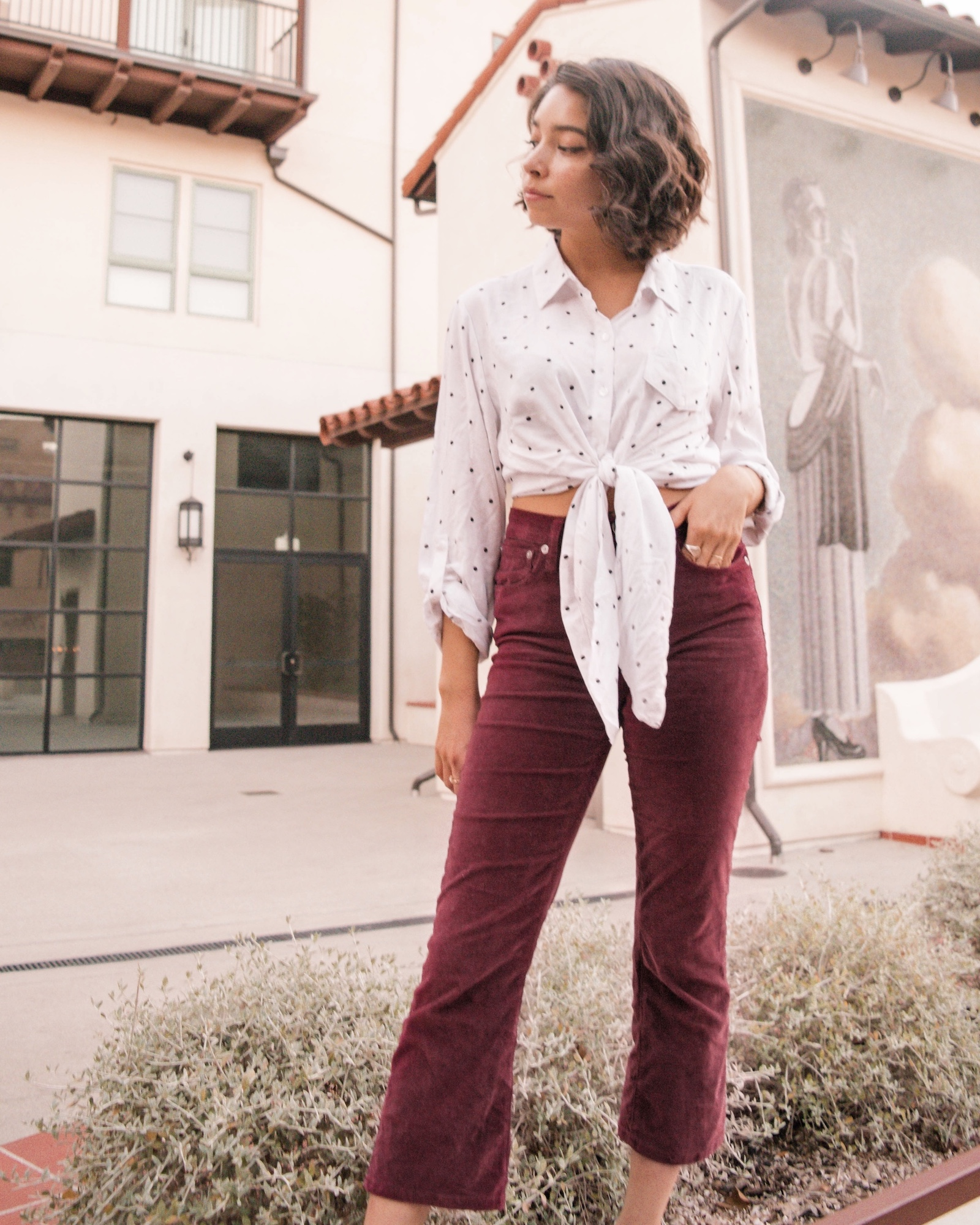 Corduroy red kick flare crop pants thrifted outfit idea // A Week Of Self-Expressive Outfits With Aja Duran From Aja With Love on The Good Trade