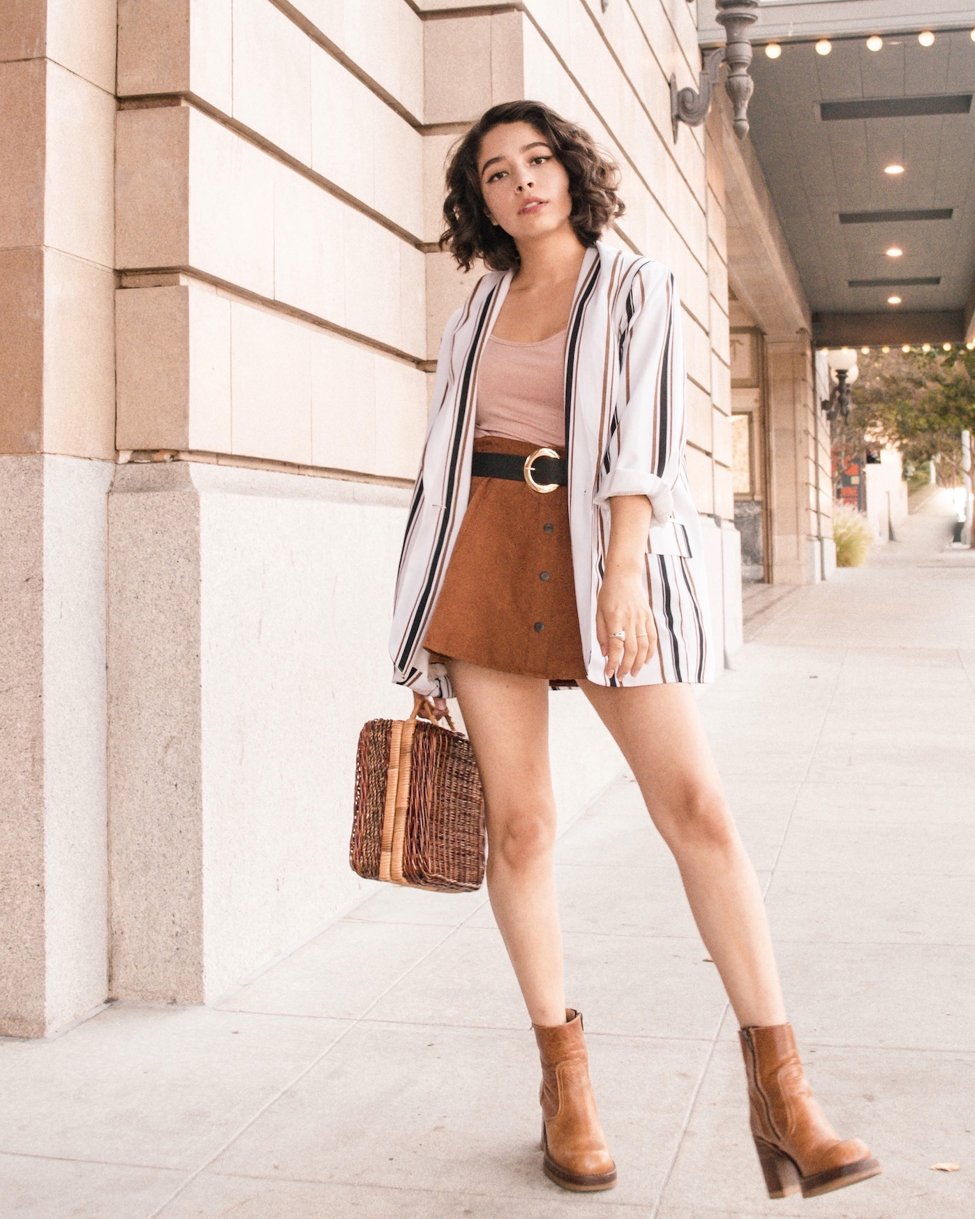 Striped blazer with mini skirt outfit idea // A Week Of Self-Expressive Outfits With Aja Duran From Aja With Love on The Good Trade