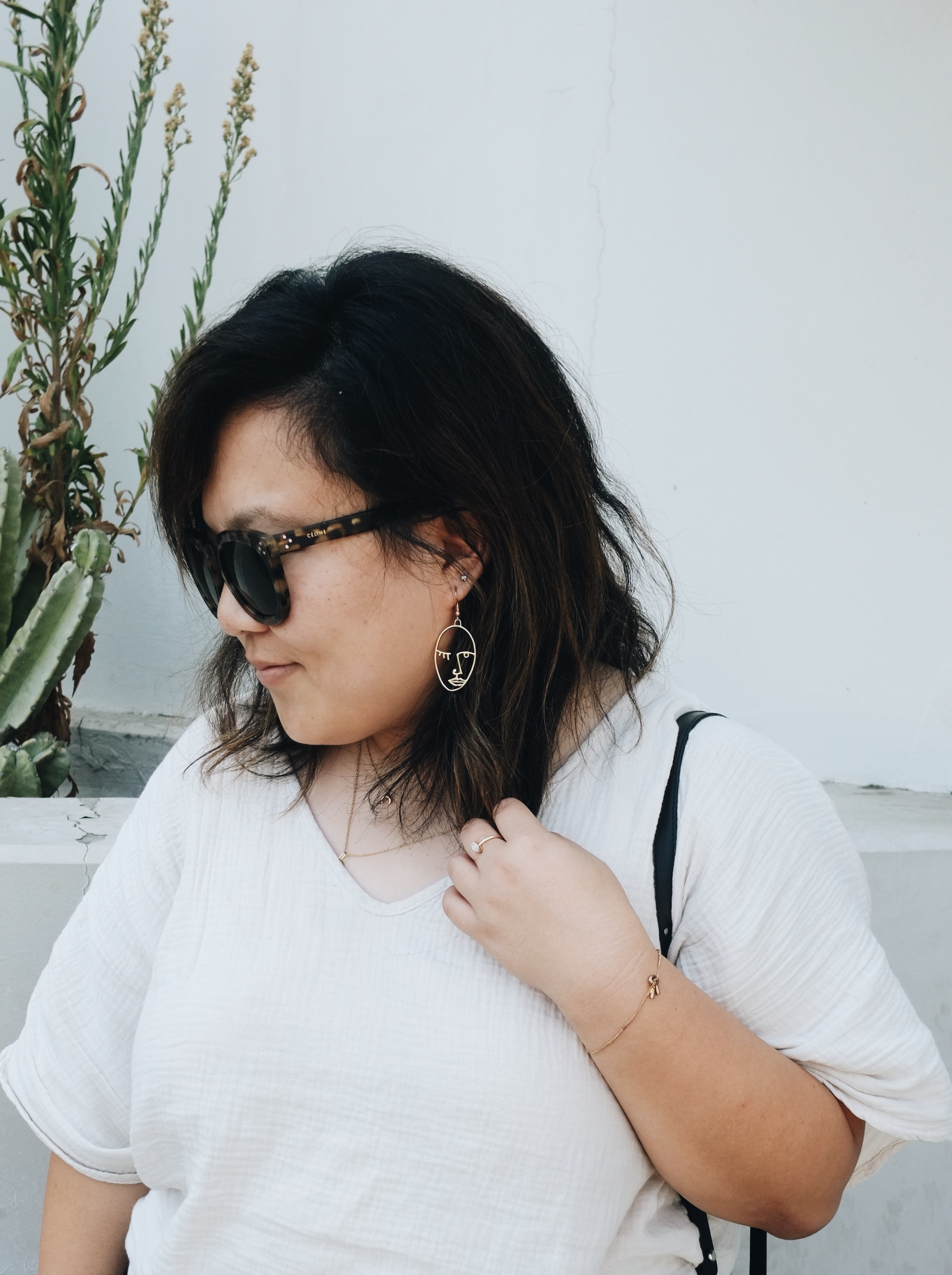 Cute minimalist line drawing earrings // A Week Of Minimalist Uniform Outfits With Jasmine Hwang From The Pleb Life on The Good Trade