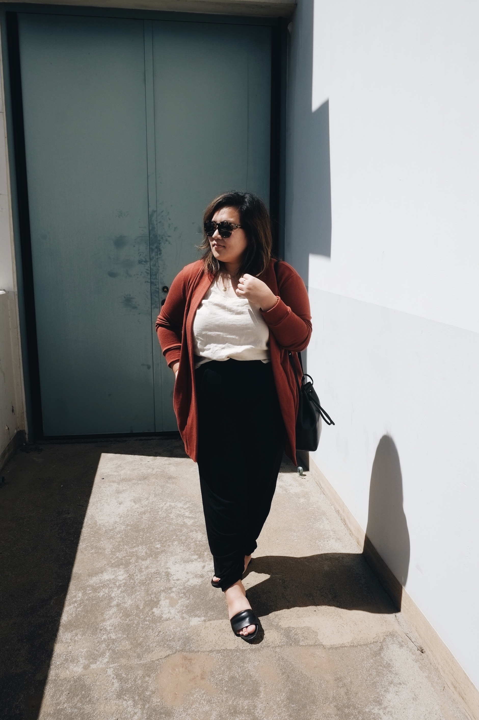 Minimalist outfit with a pop of rust red // A Week Of Minimalist Uniform Outfits With Jasmine Hwang From The Pleb Life on The Good Trade