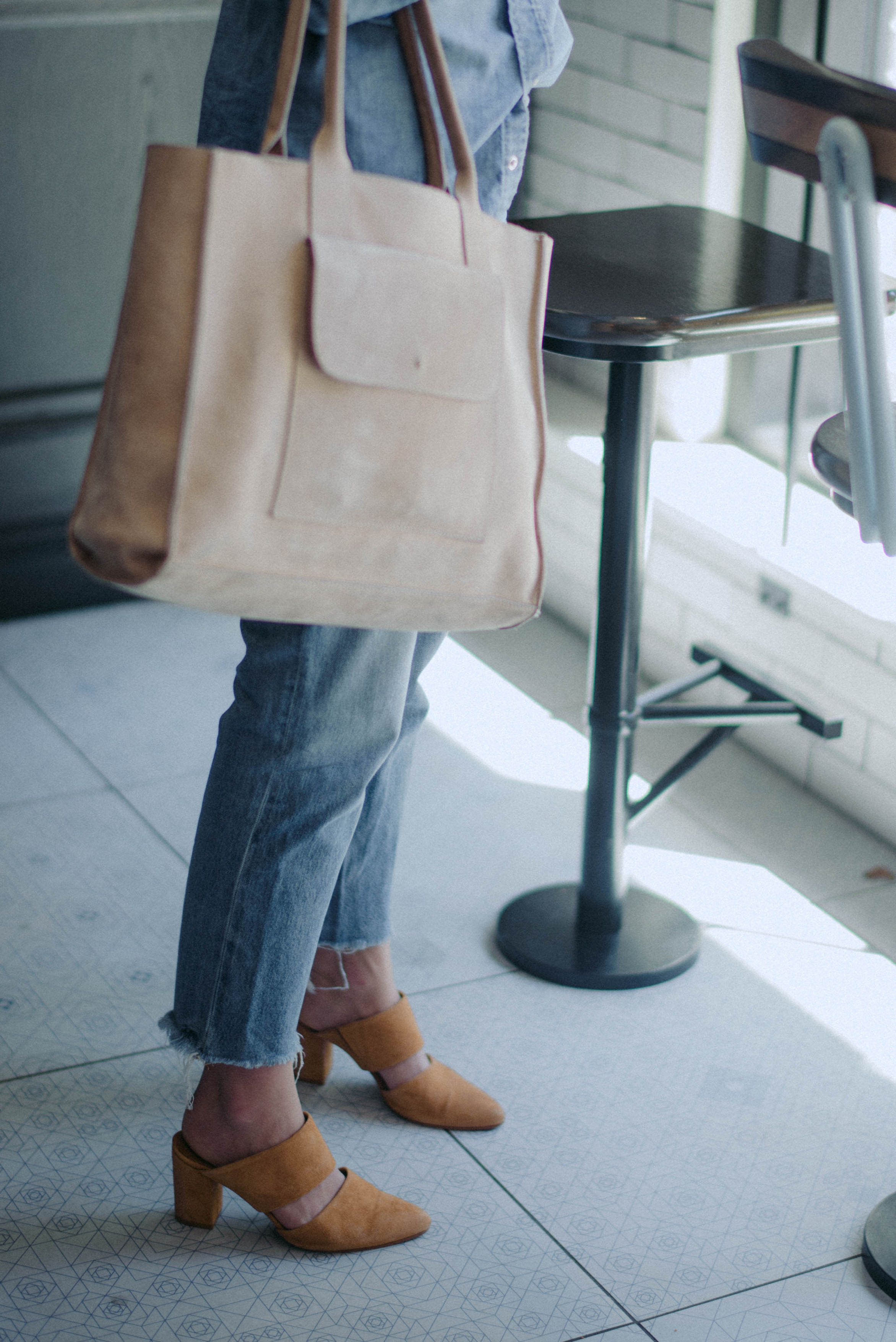 Denim on denim outfit with leather details // A Week Of  Nashville-Chic Ethical Outfits With Jordan Soderholm, Fashion Director At ABLE on The Good Trade